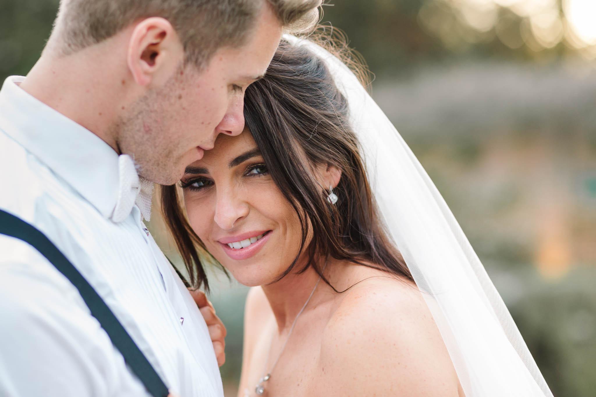close up photo of bride and groom - elegant and stylish wedding