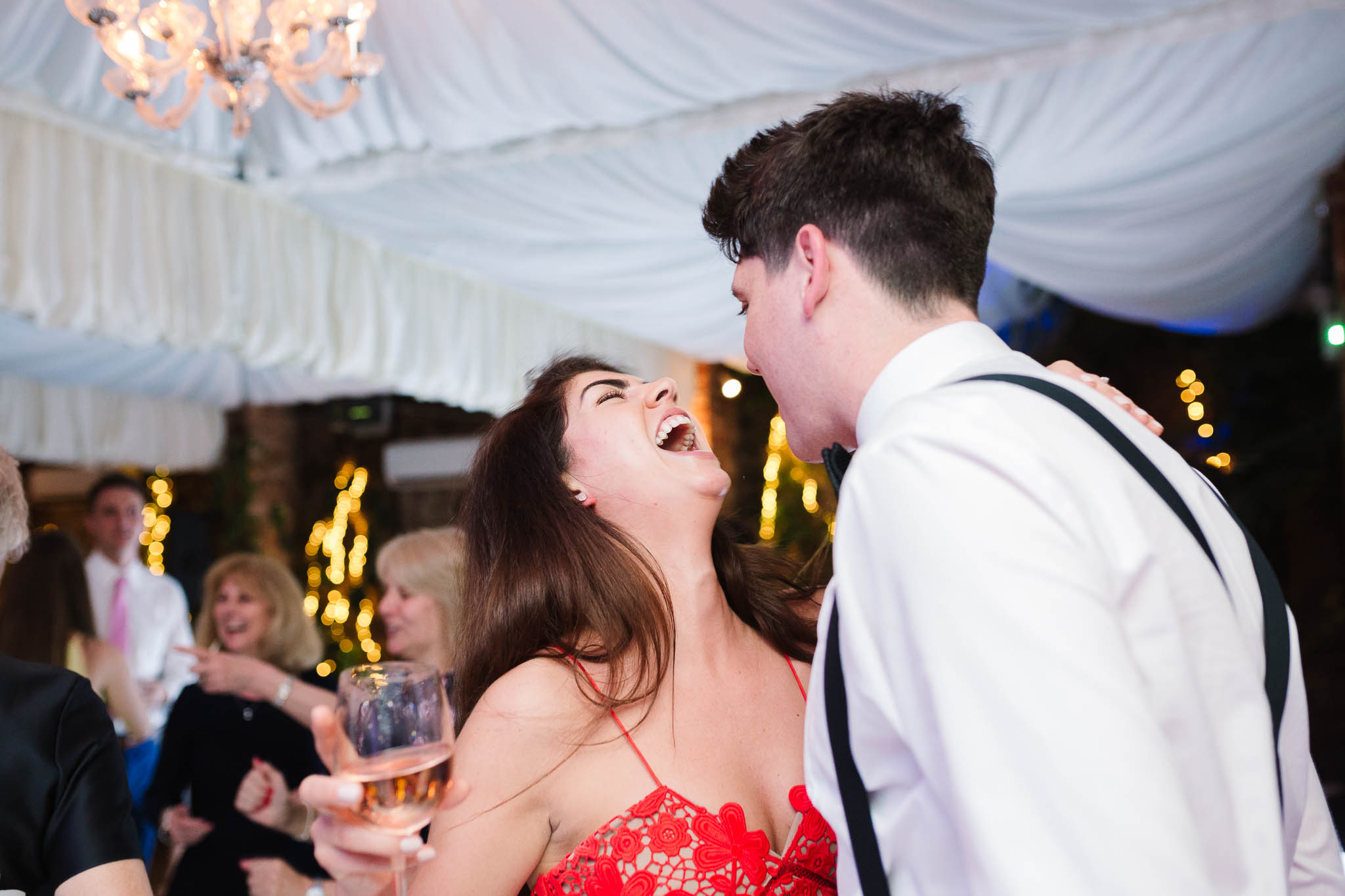 wedding guests dancing and laughing