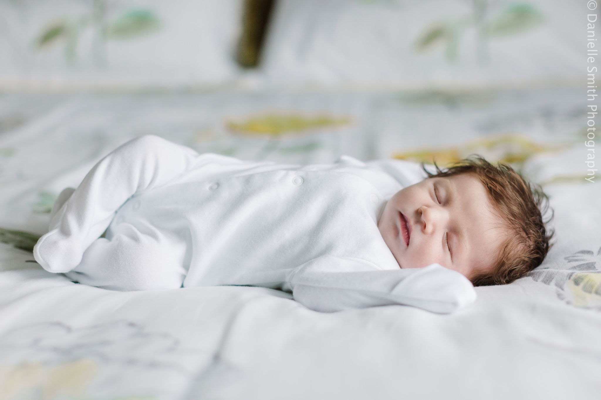 newborn baby sleeping on bed - Relaxed Newborn Baby Photography in South London