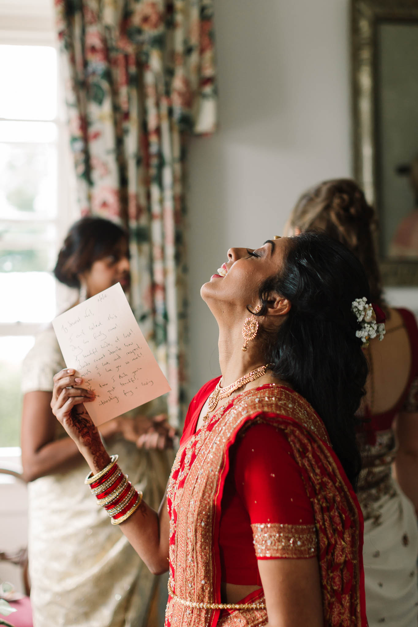 bride trying not to cry after reading message from fiancé