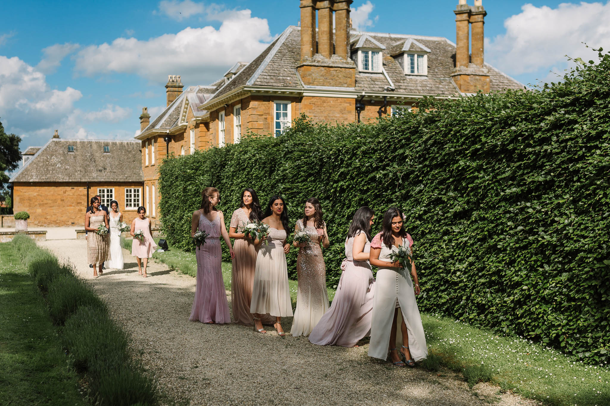 bride and bridesmaids walking to wedding