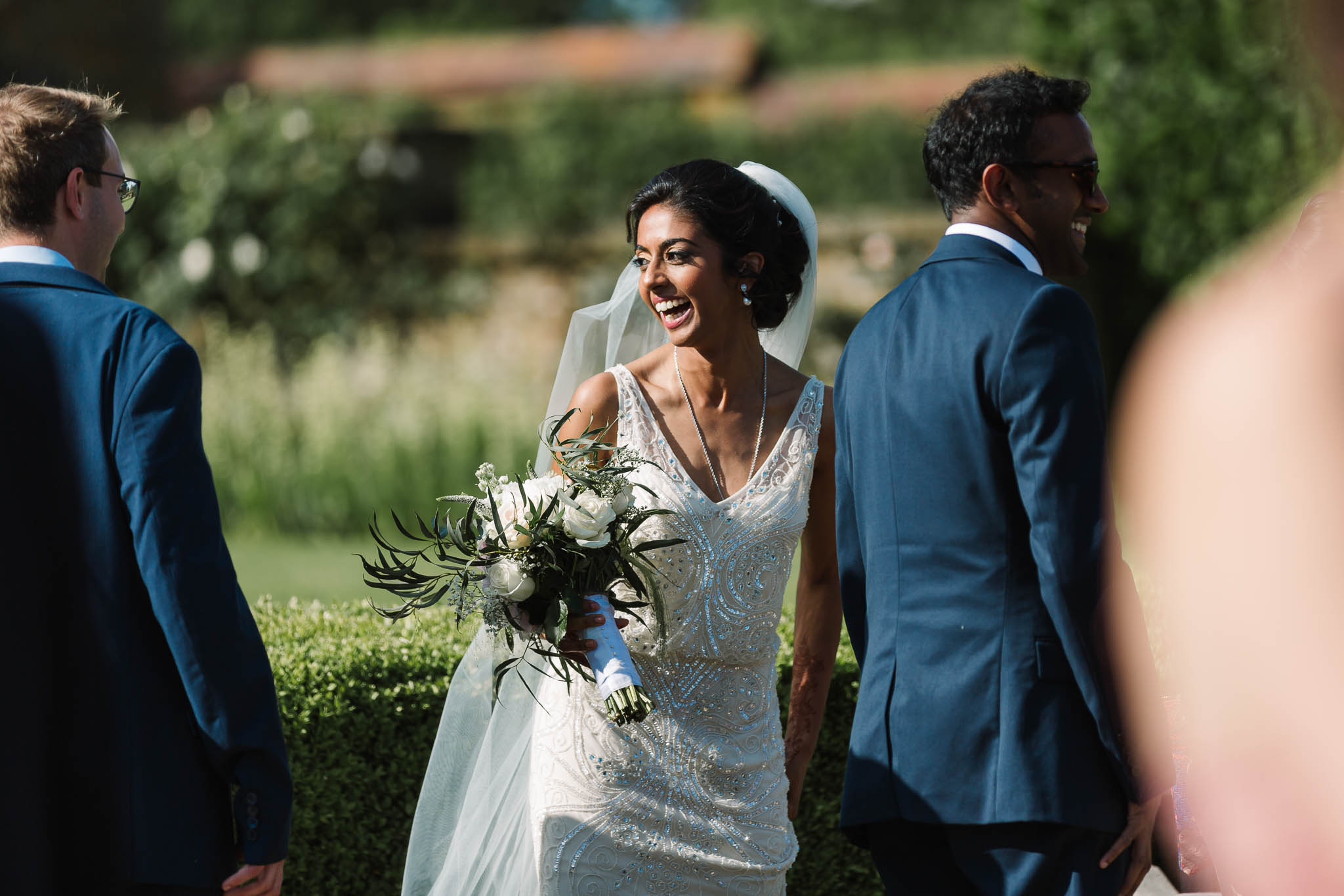 bride laughing in sun