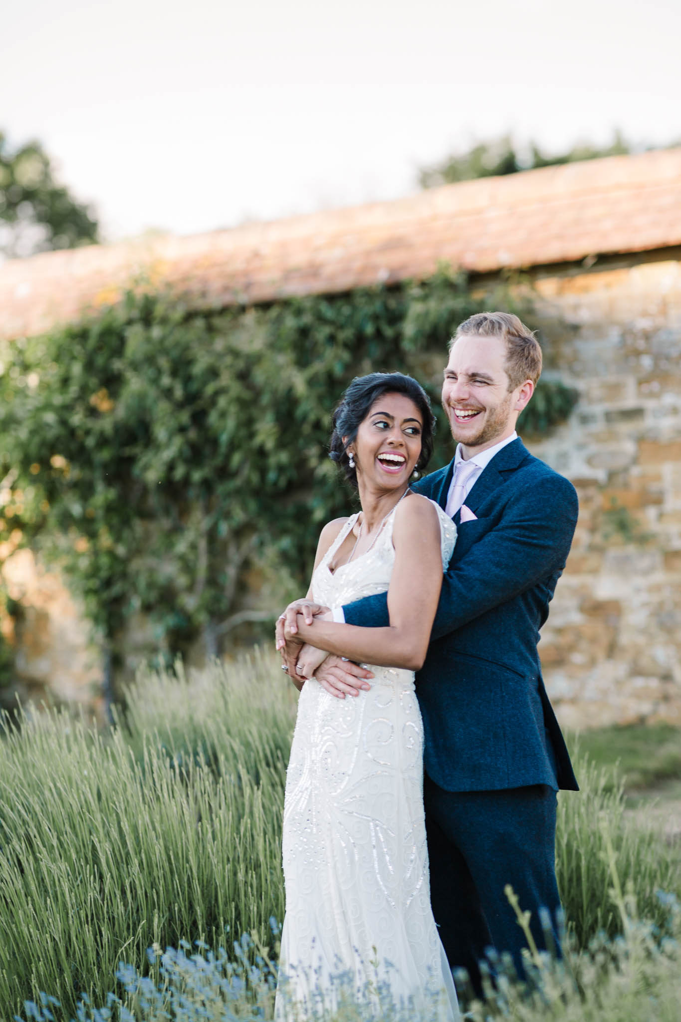 bride and groom smiling in gardens