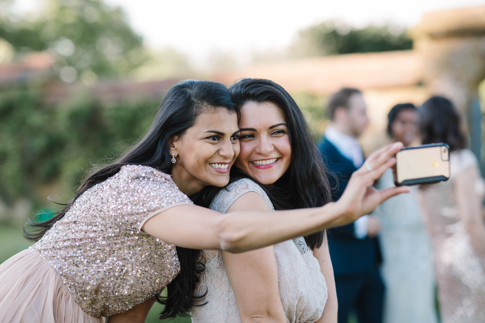 bridesmaids having selfie at wedding