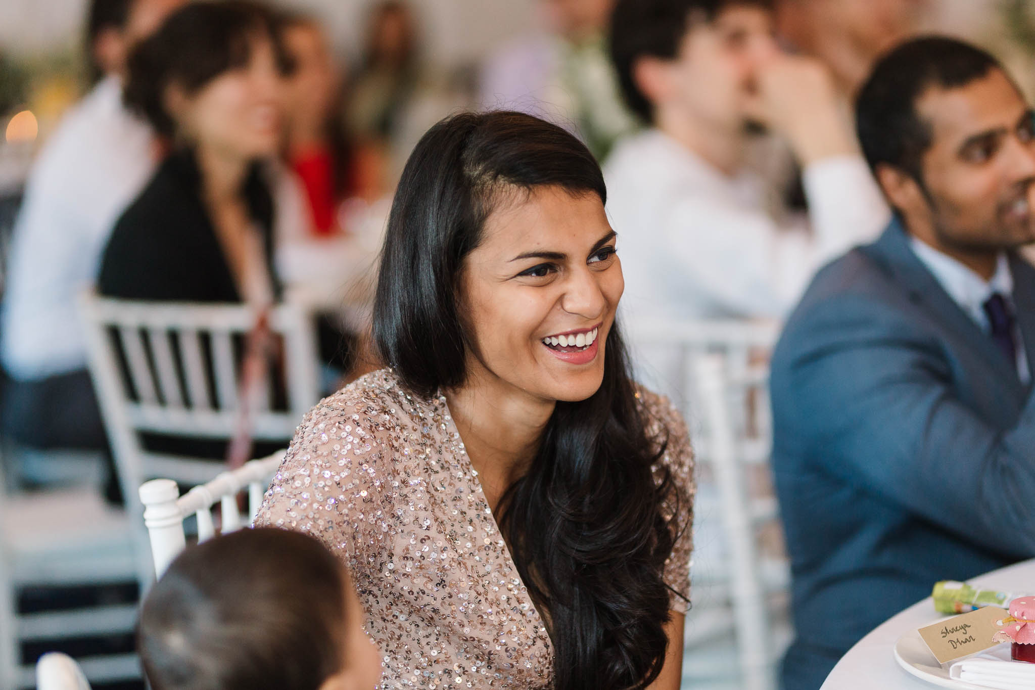 bridesmaid laughing at speeches