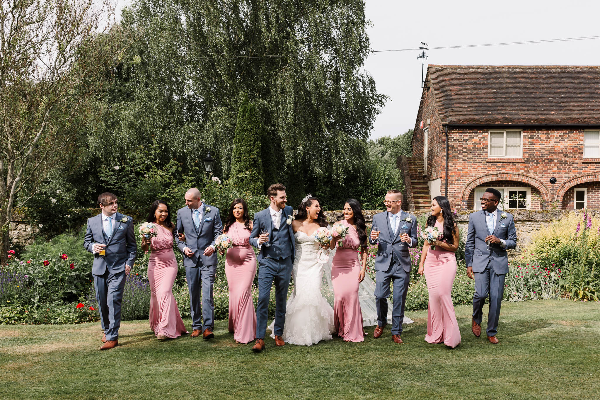 bridal party walking at brewerstreet farmhouse wedding
