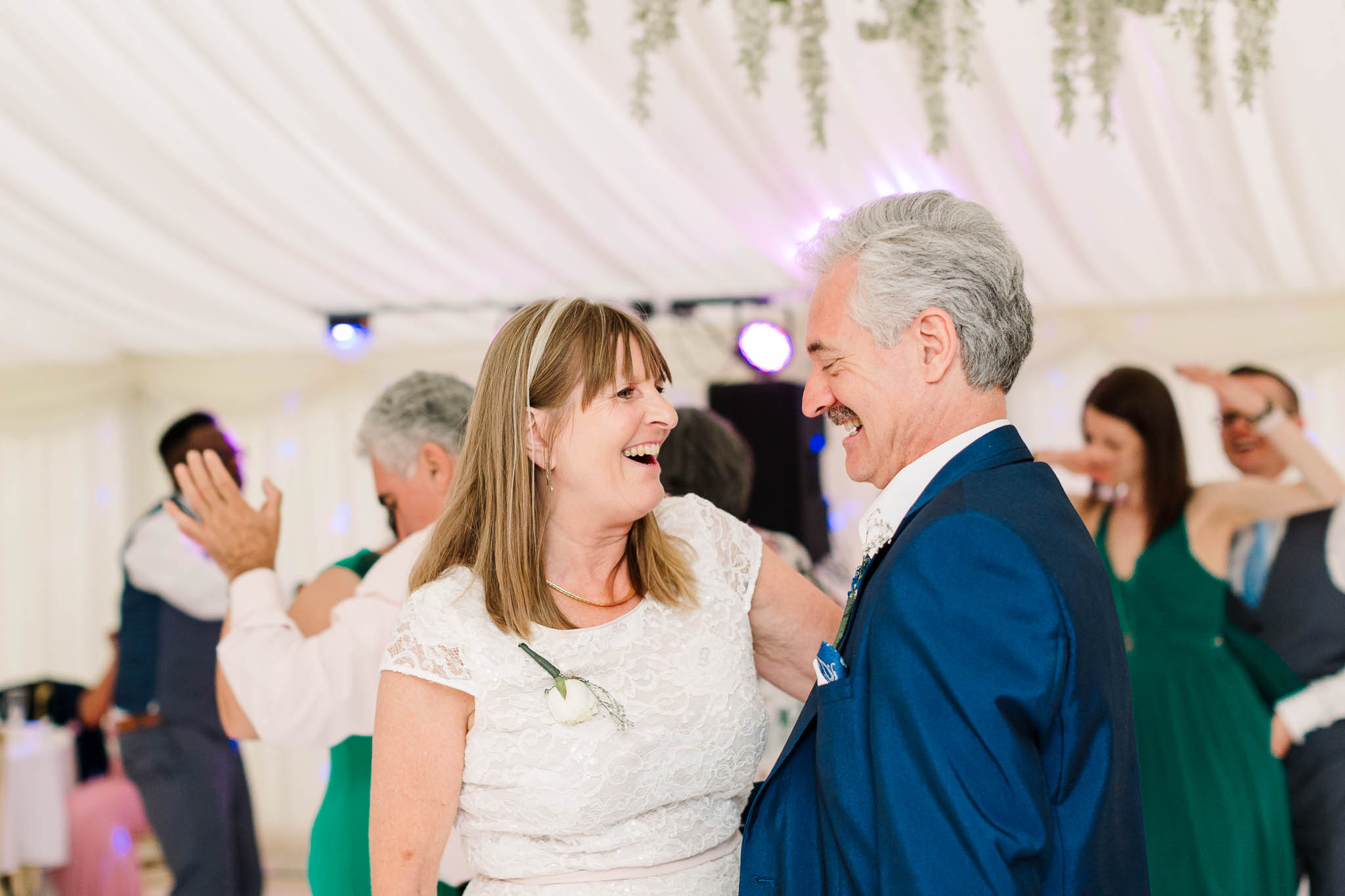 parents dancing at fun and relaxed wedding