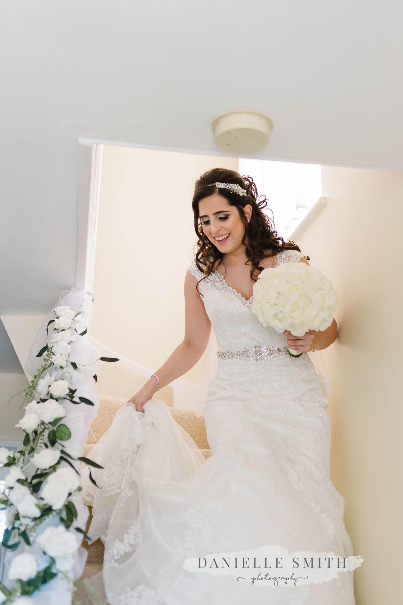 bride walking down stairs in dress