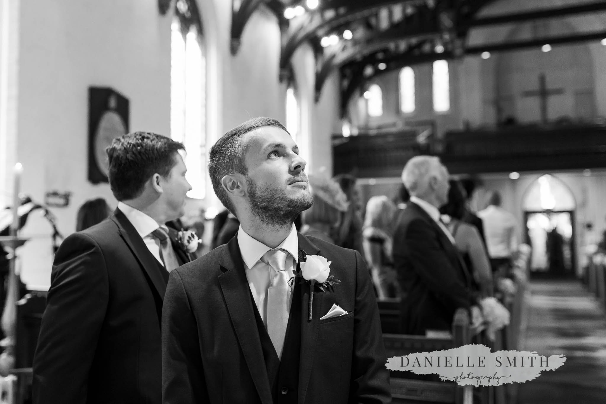 groom waiting for bride at front of aisle