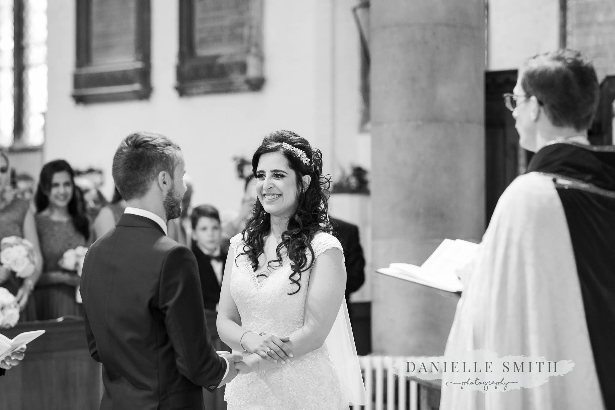 bride and groom taking vows in church