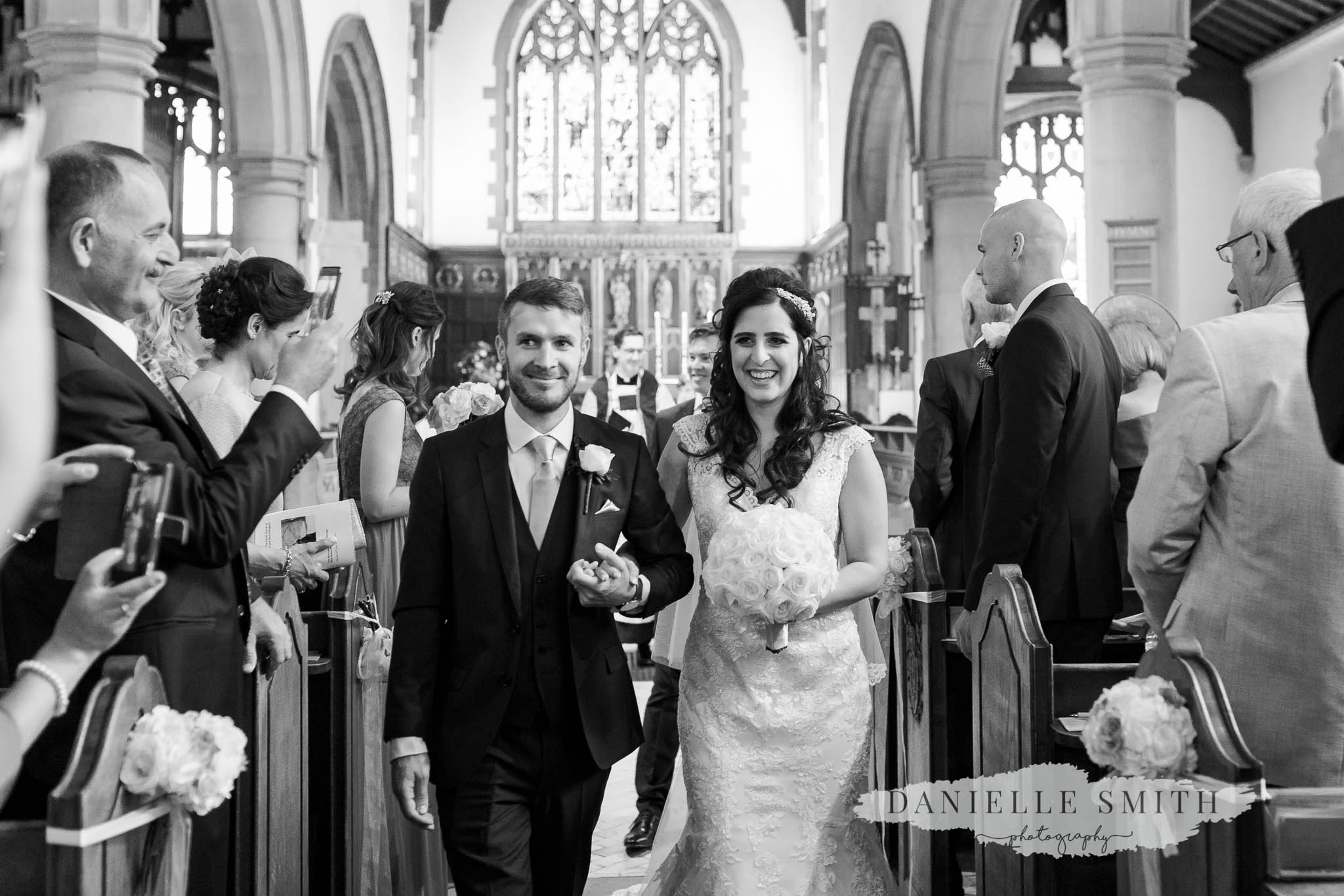 turkish bride and english groom walking down aisle