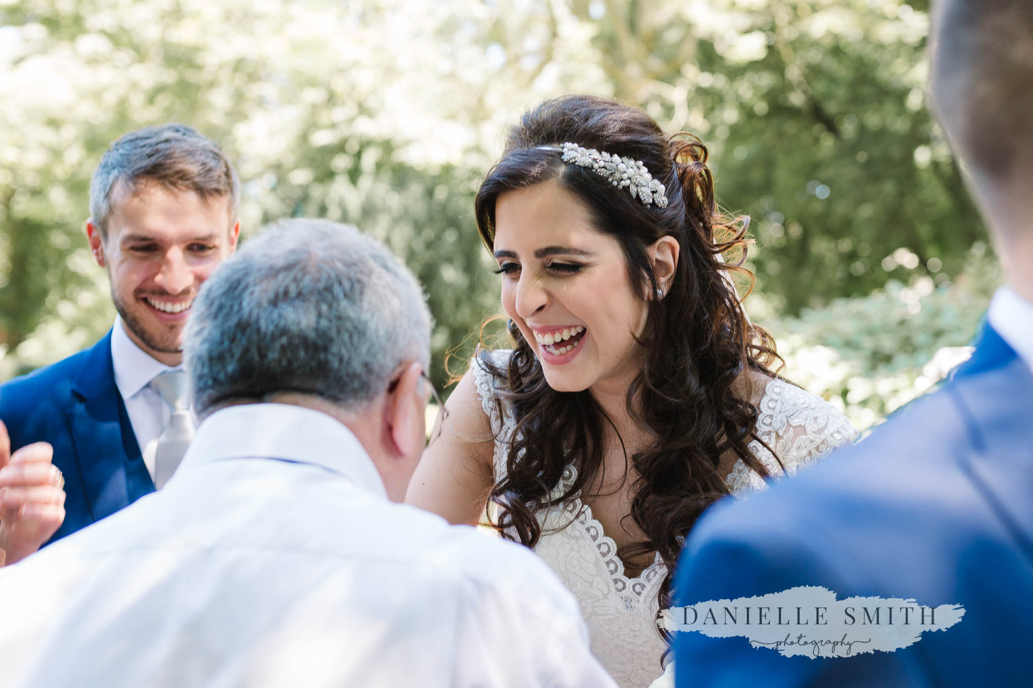 bride smiling and greeting guests