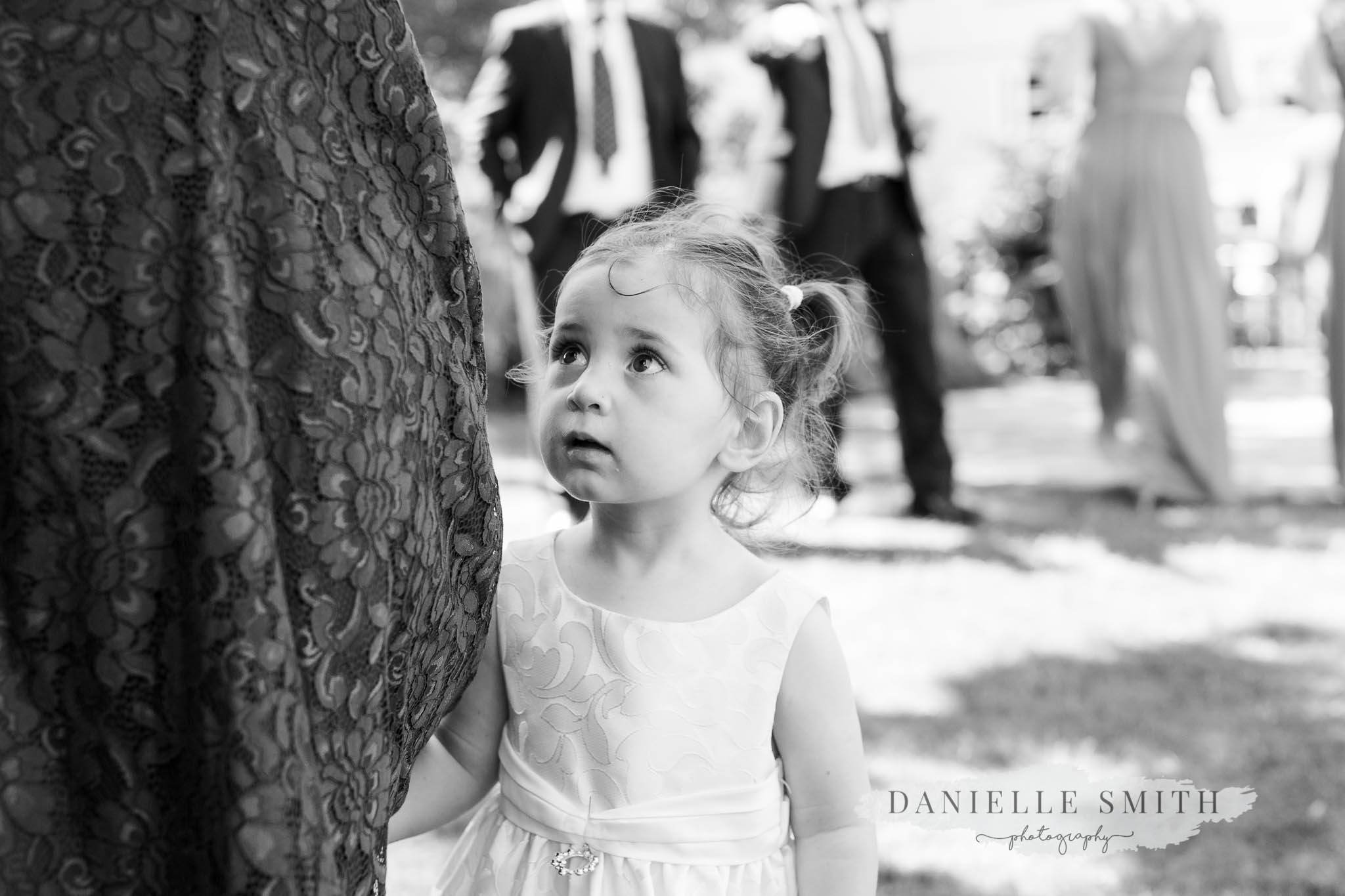 little girl at chilled turkish-english wedding