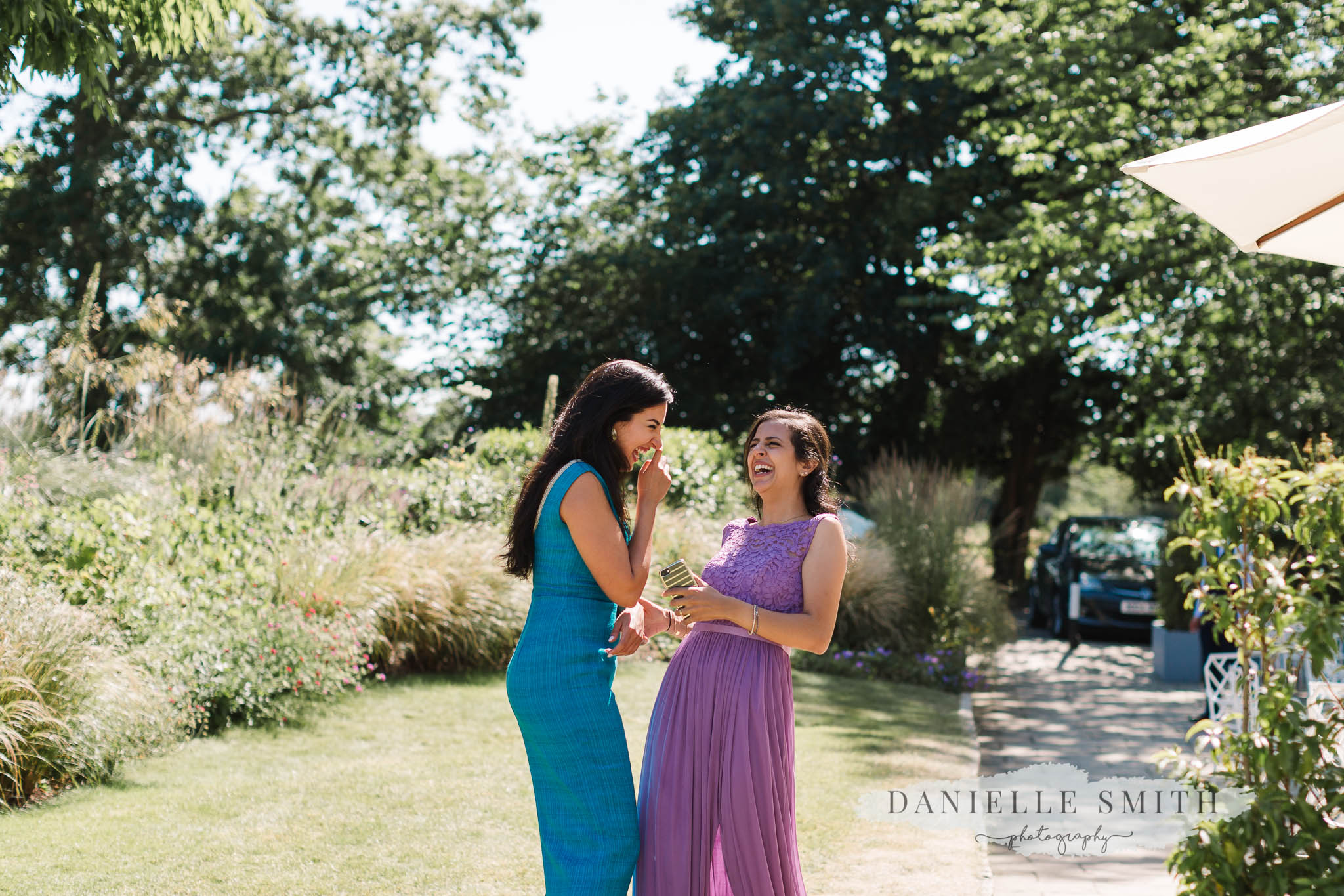 wedding guests laughing at chilled summer wedding