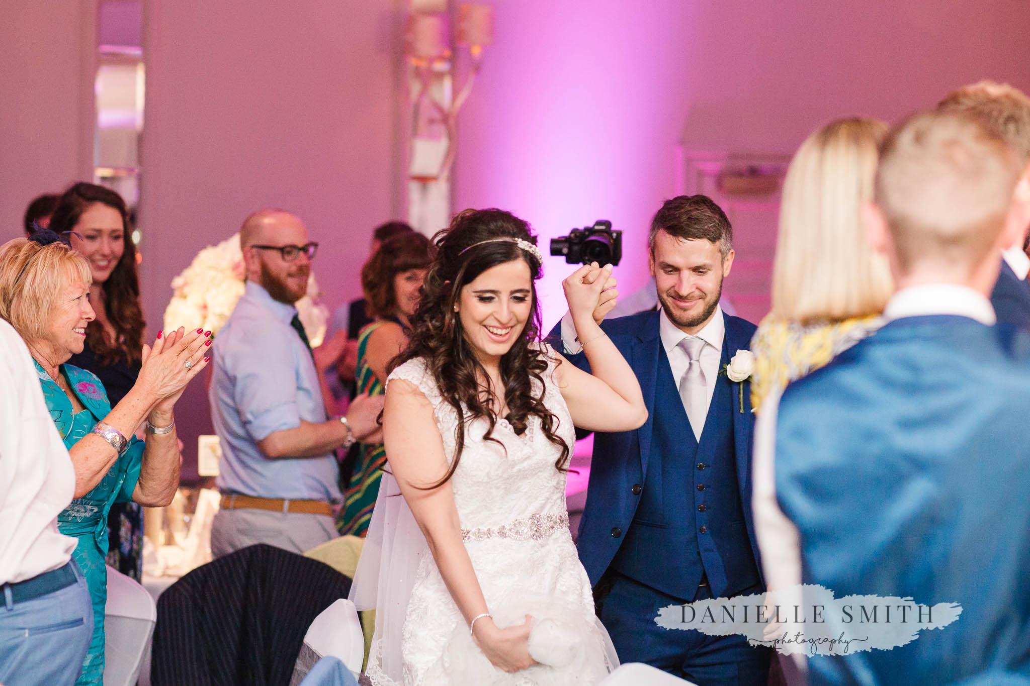 bride and groom entrance to reception room