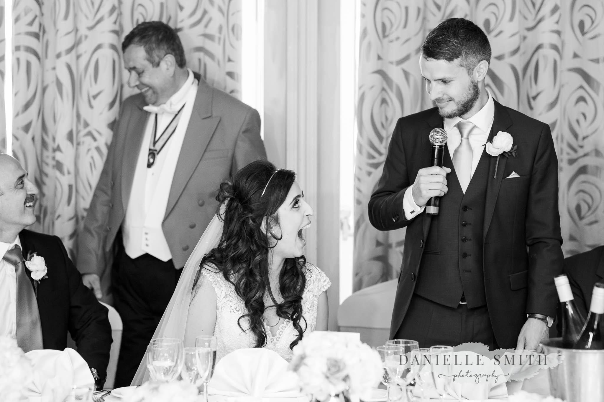 groom giving speech to turkish wife