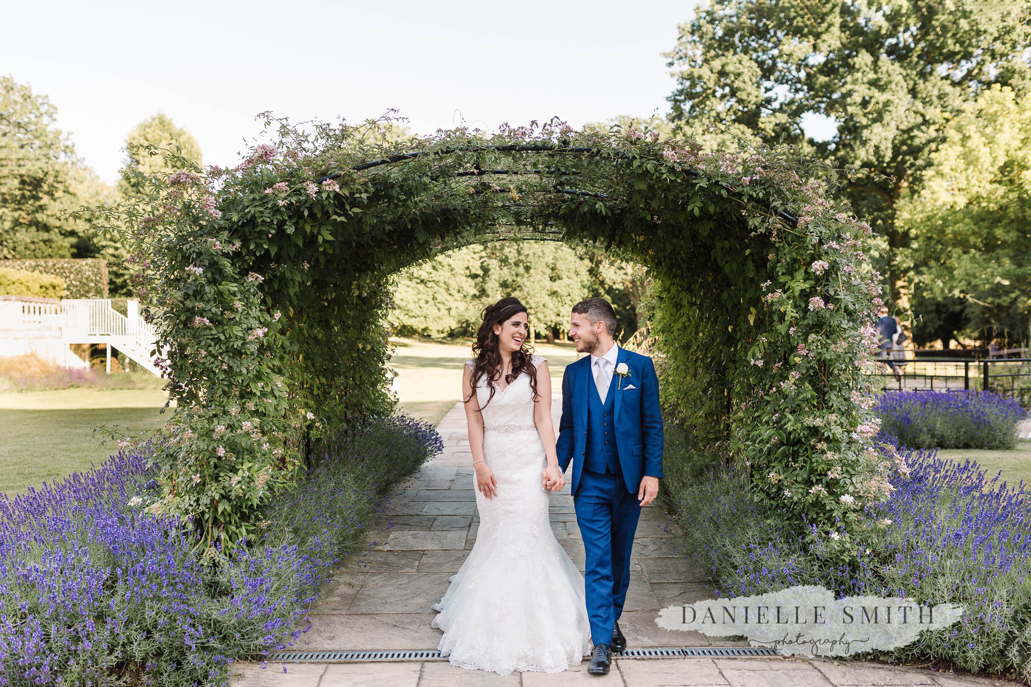 bride and groom walking at chilled summer wedding