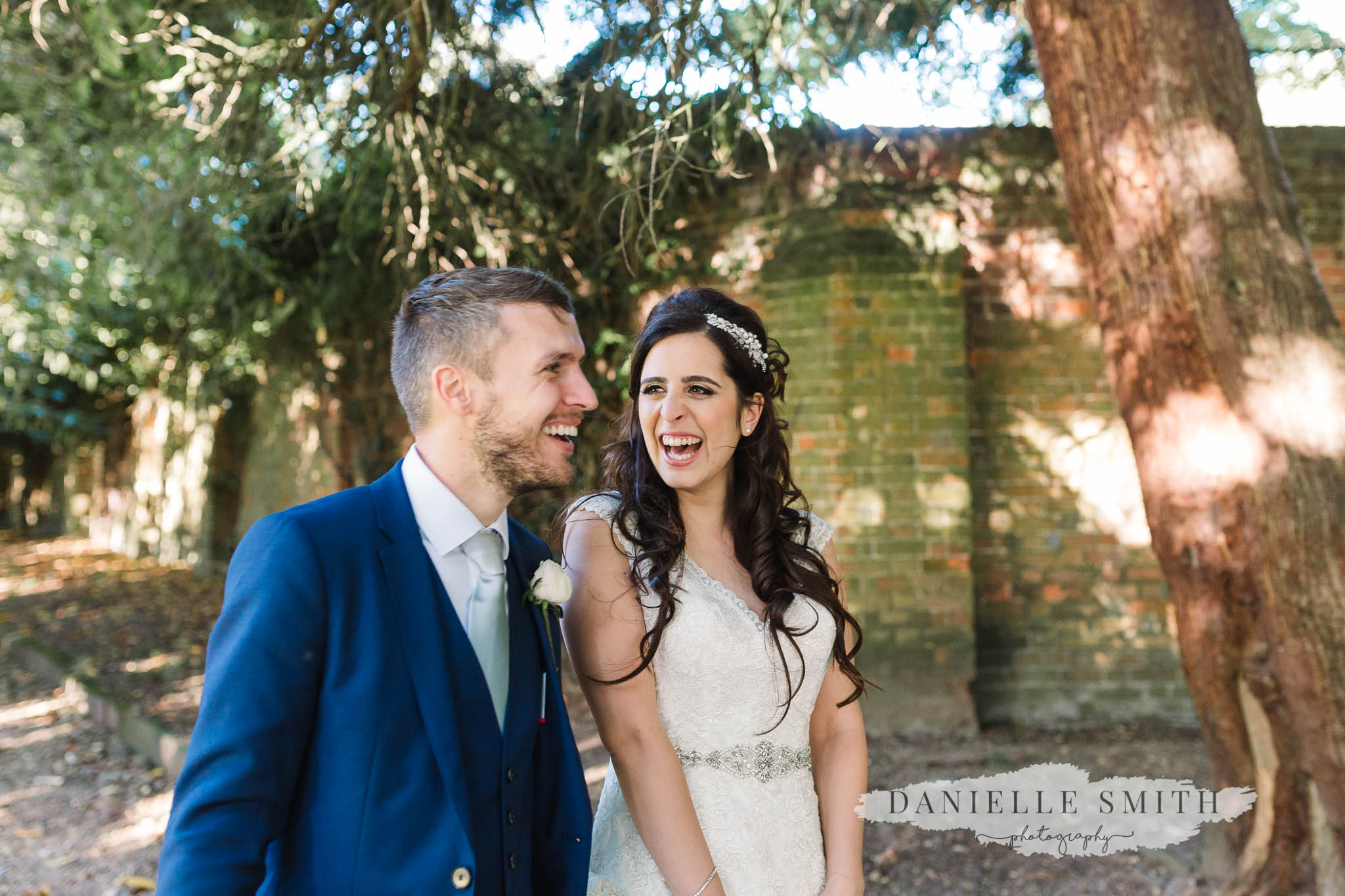 bride and groom laughing at sopwell house