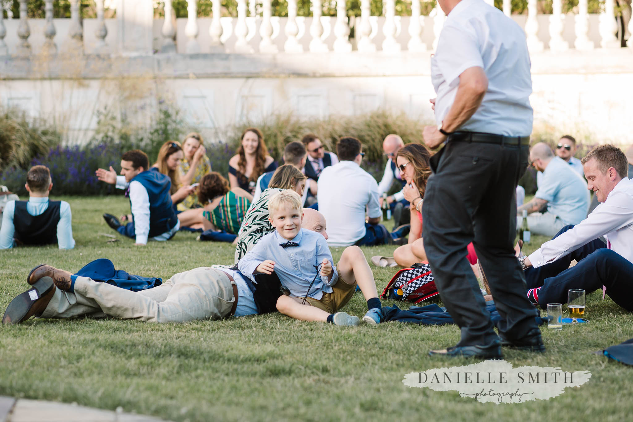 wedding guests chilling in sun
