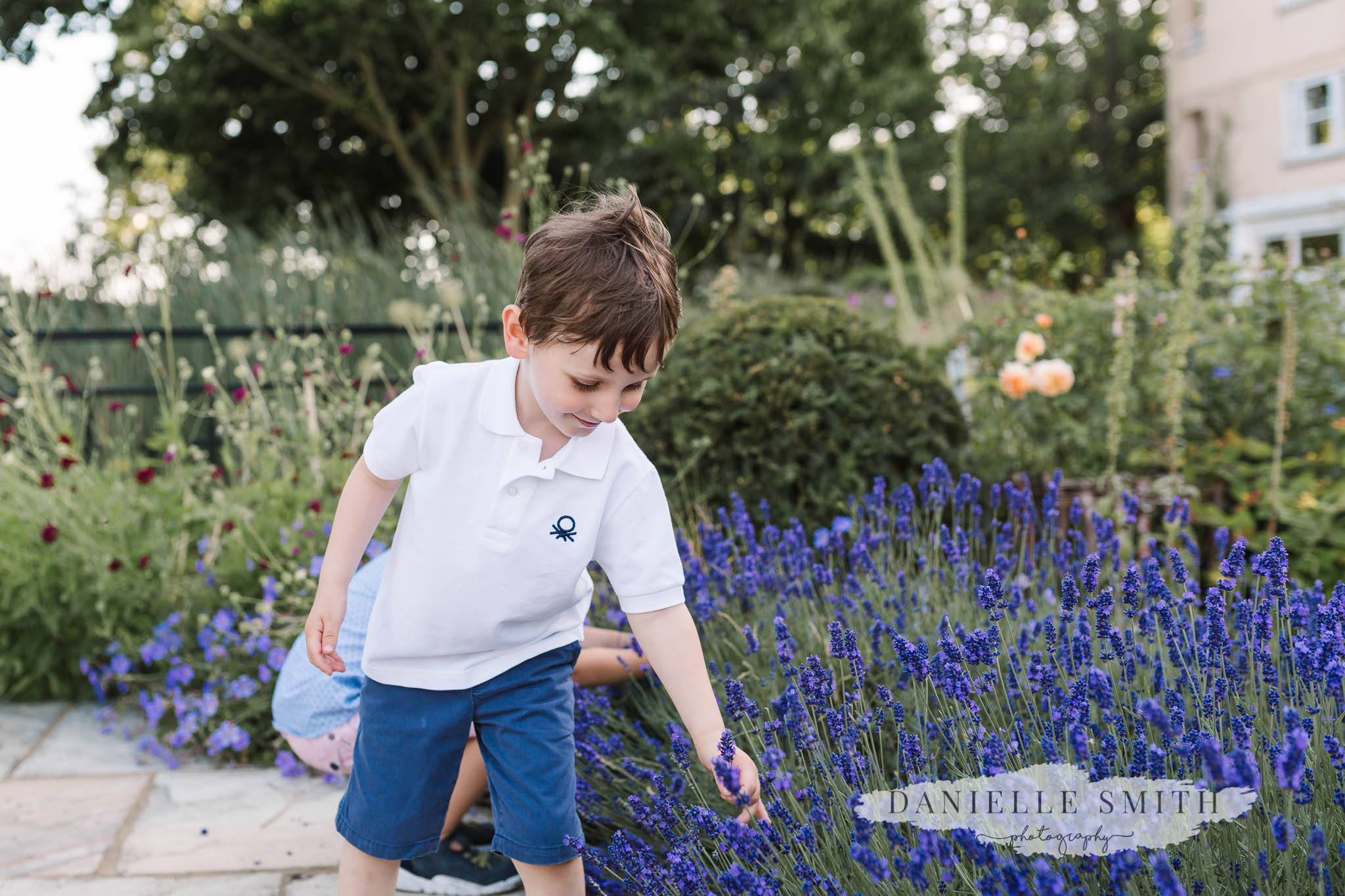 page boy picking flowers