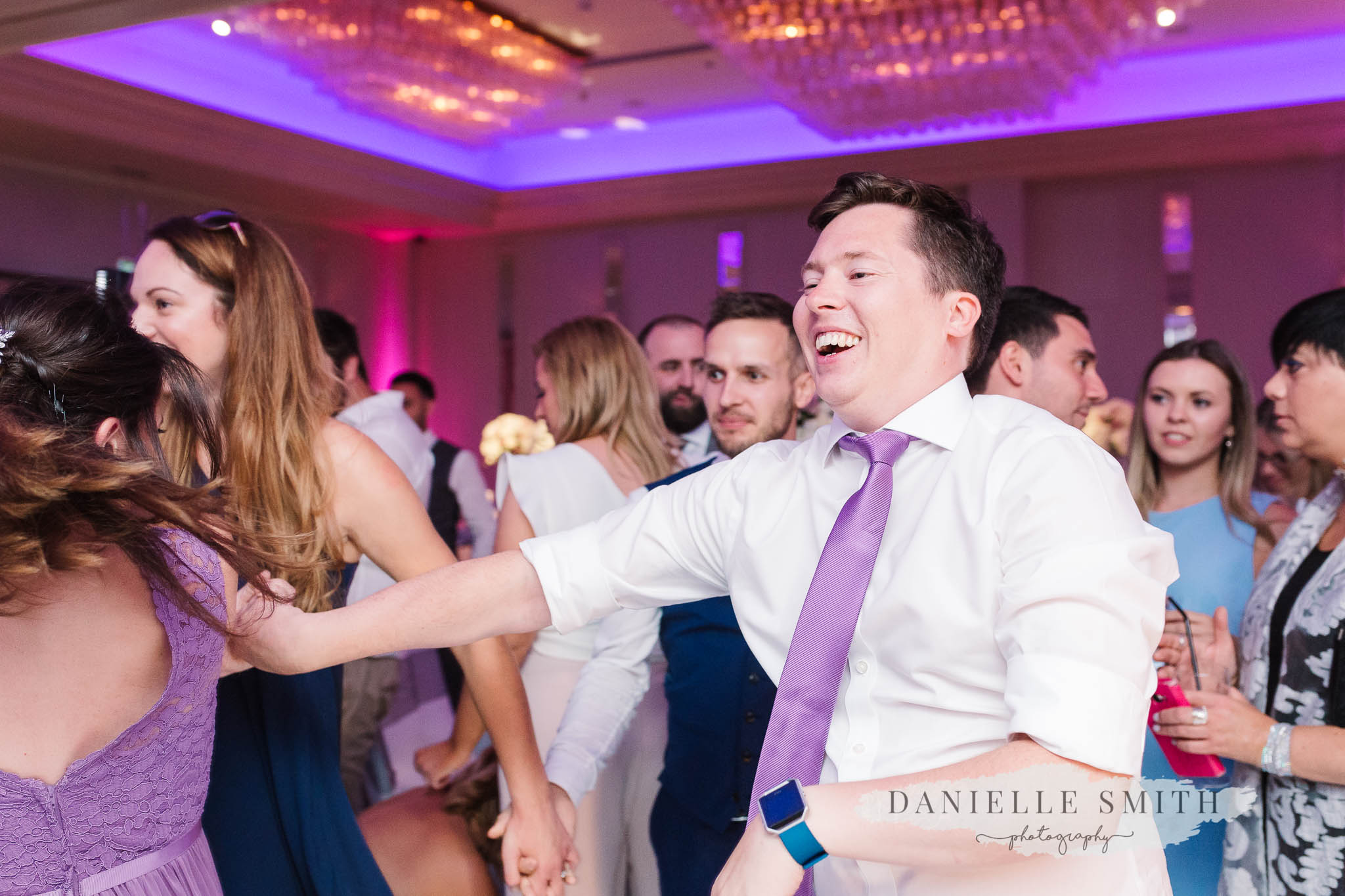 groomsman dancing at wedding