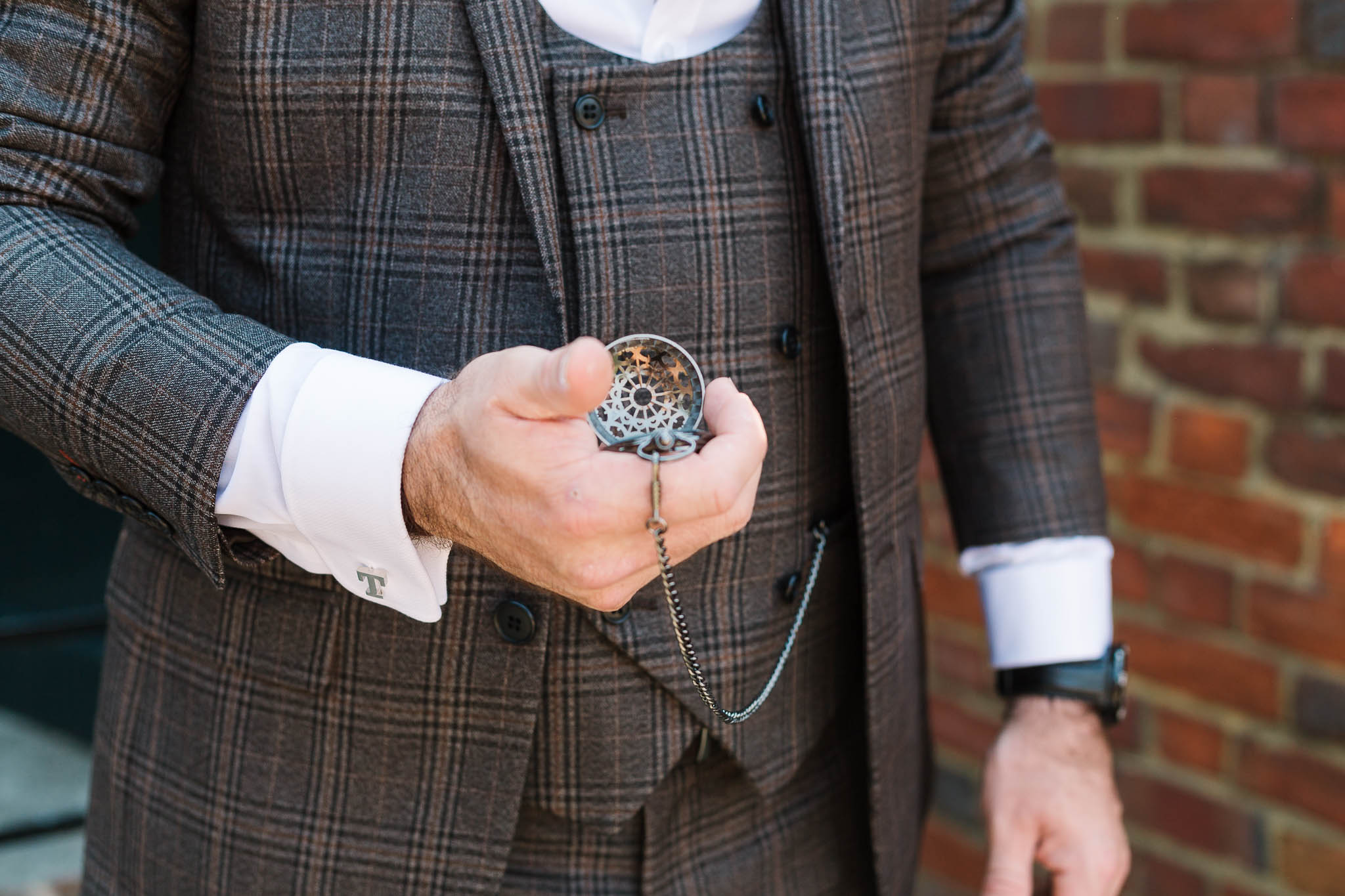 pocket watch and tweed suit
