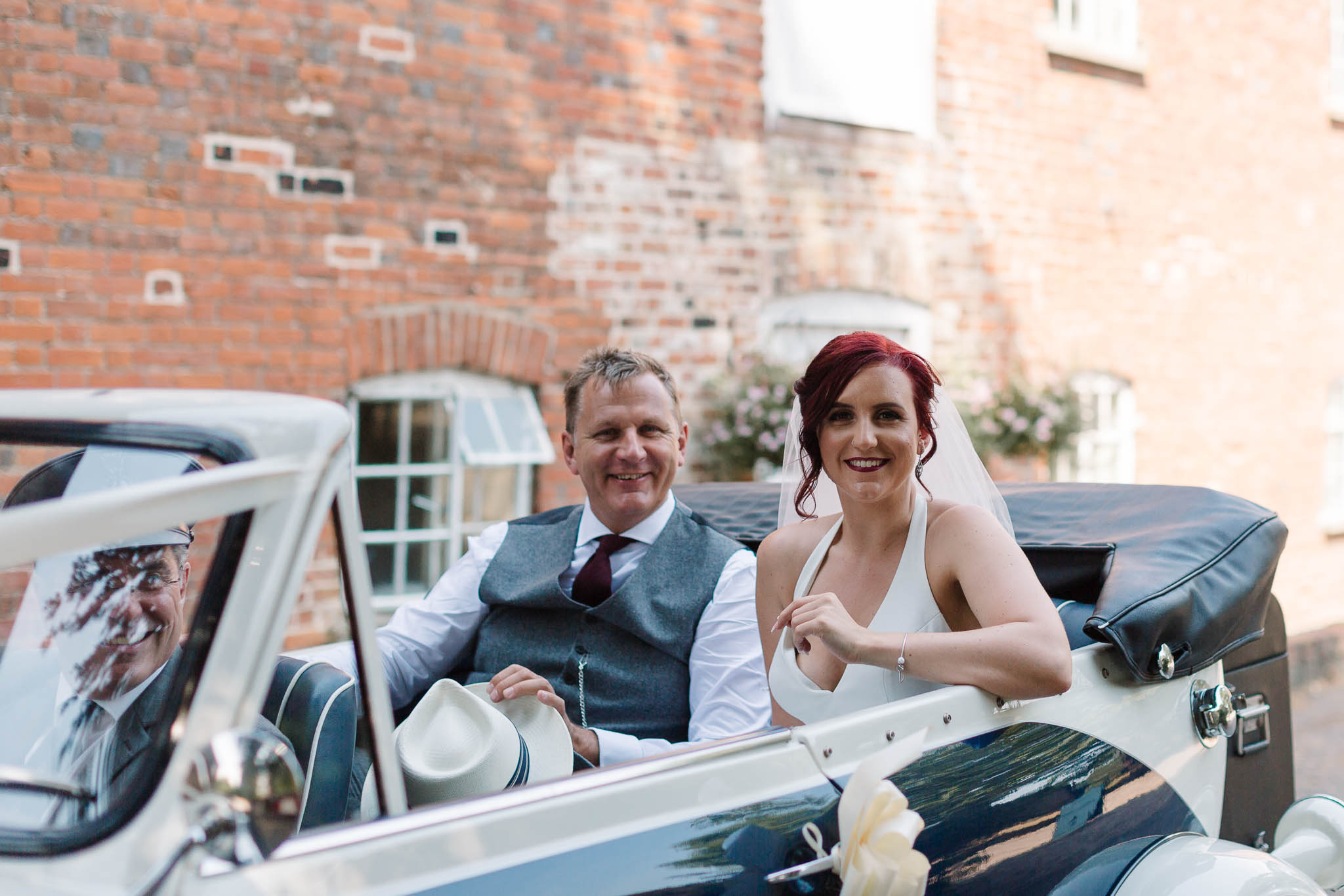 bride and dad arrive in vintage convertible bentley