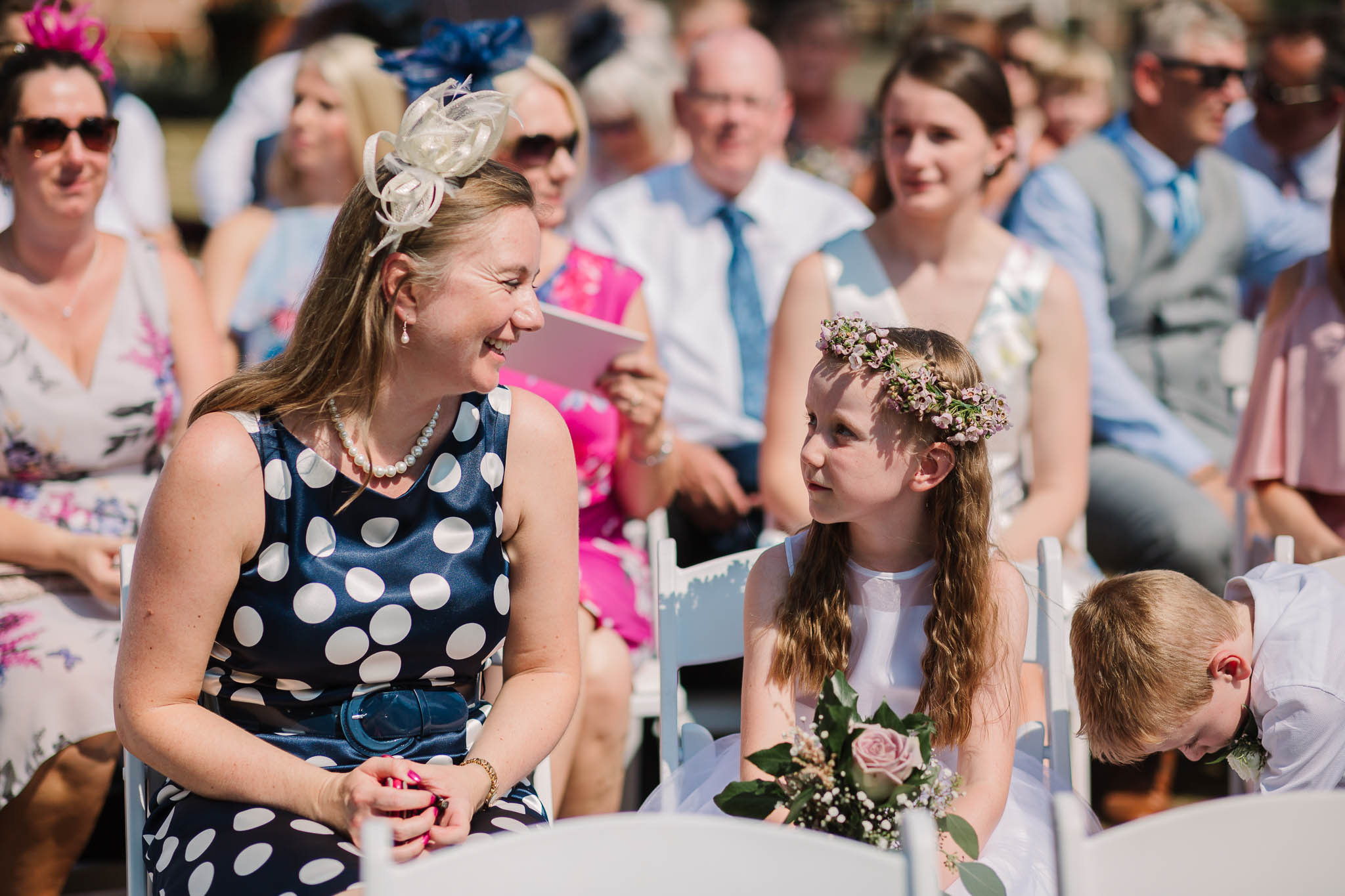 flower girl and mum at outdoor ceremony