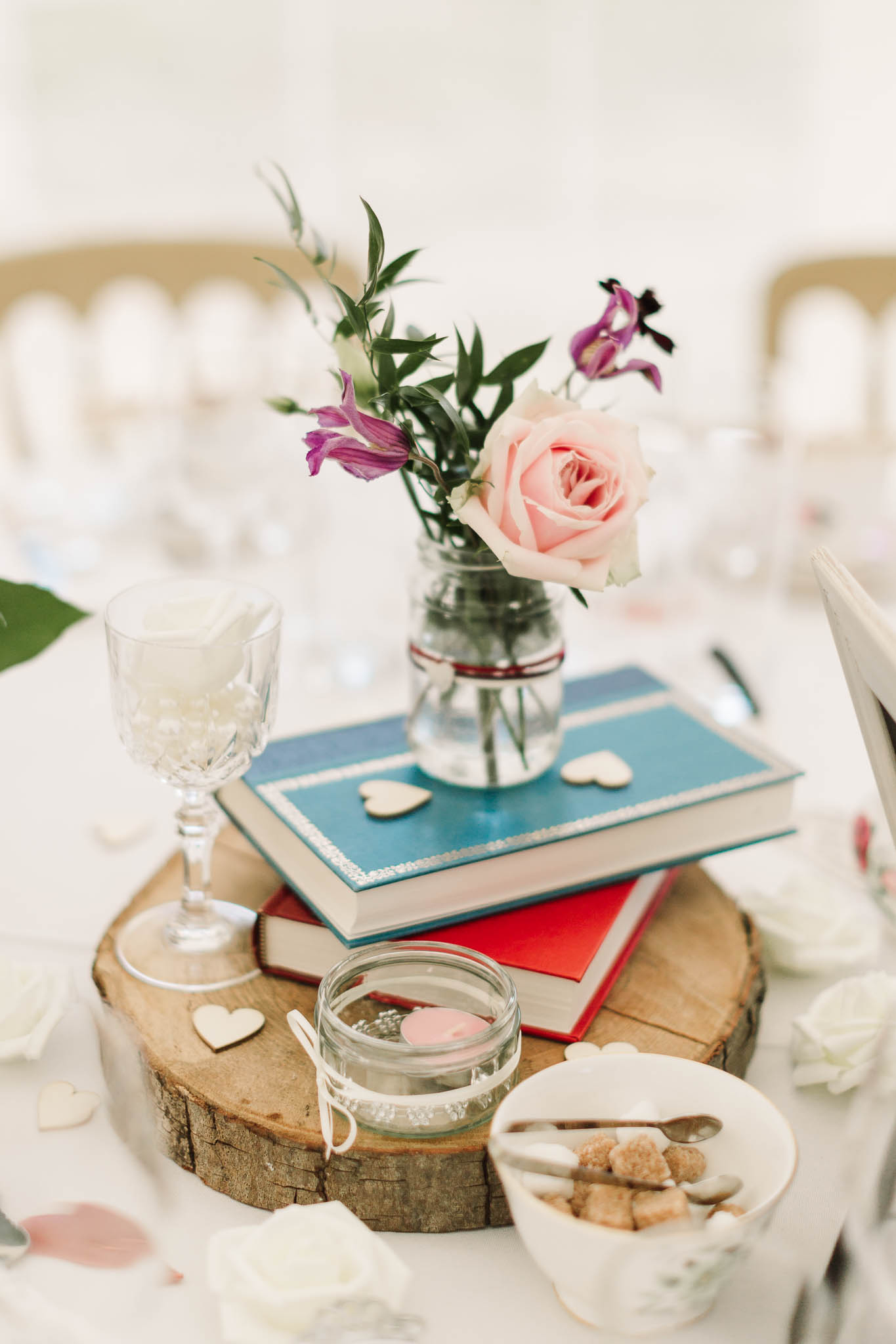 flower jars on tables at wedding