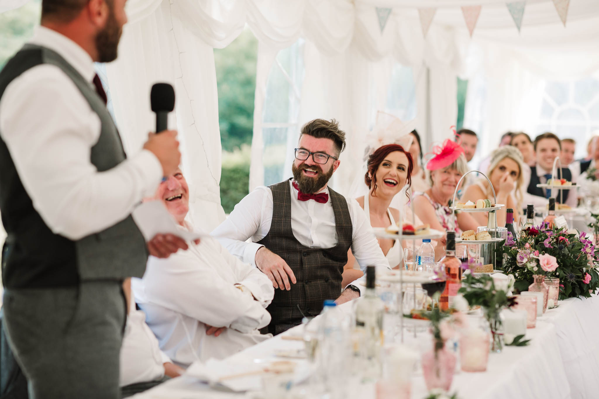 top table laughing at best mans speech