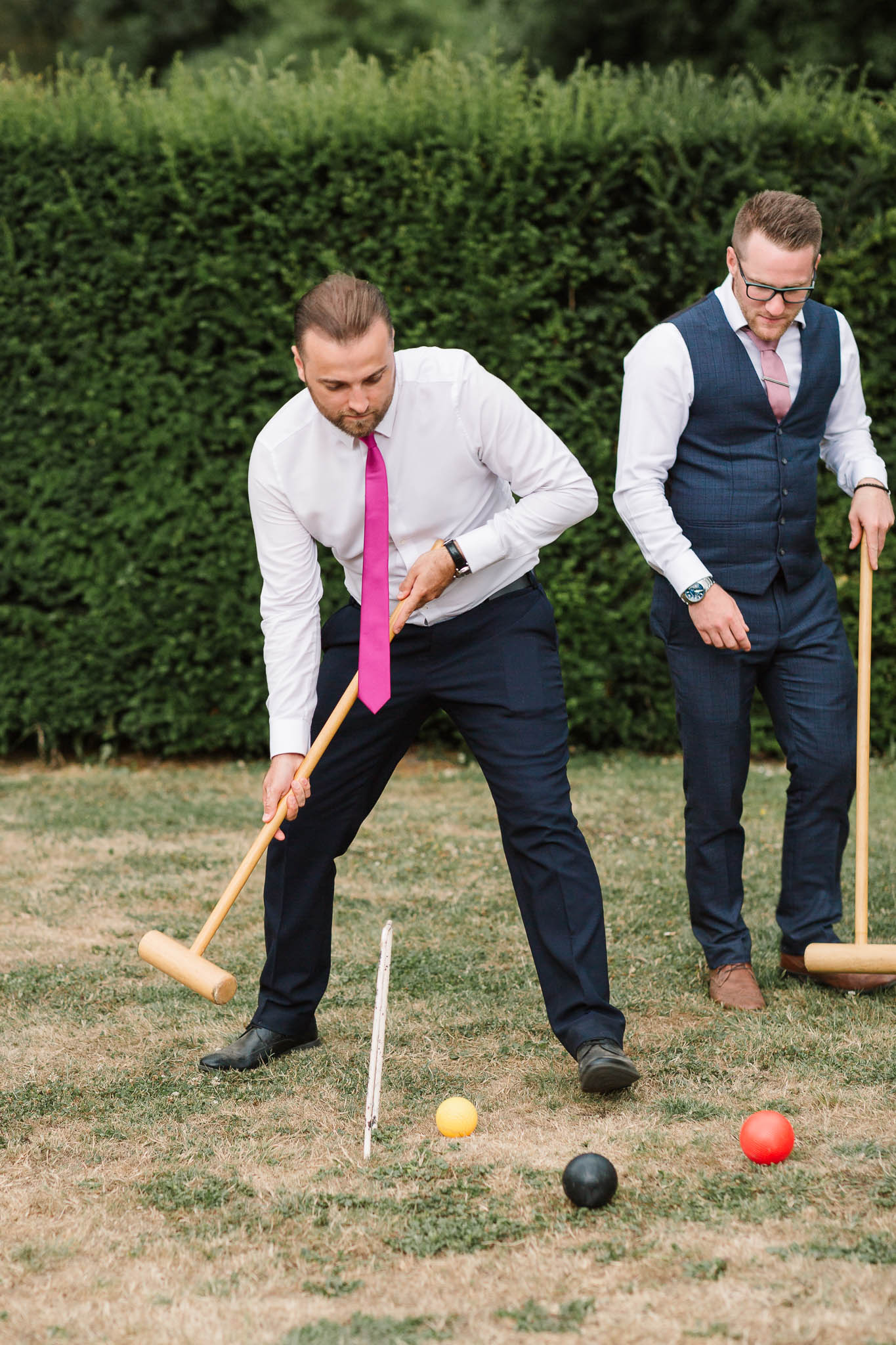wedding guests playing croquet at english country wedding