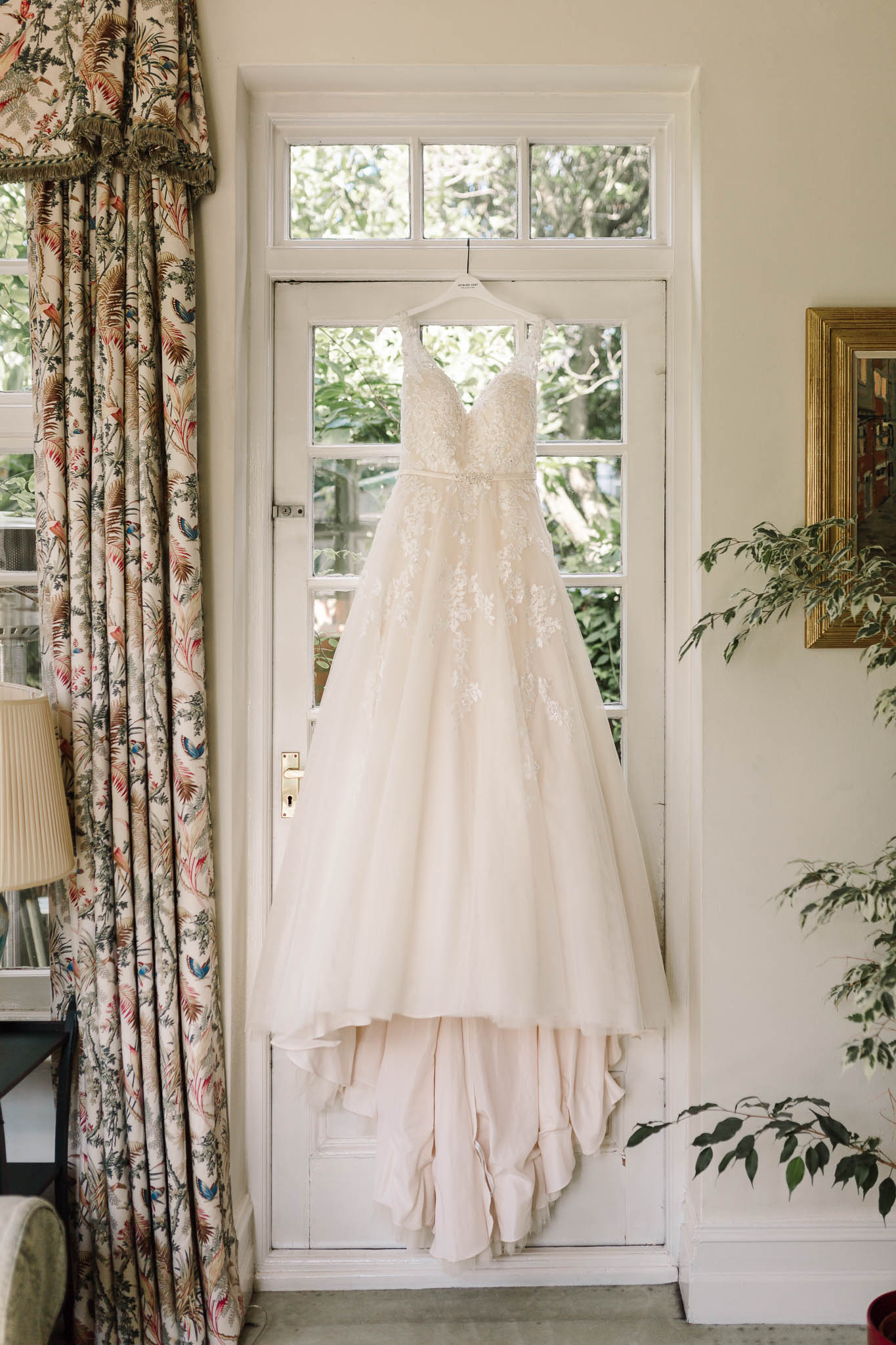 kenneth winston wedding dress hanging up