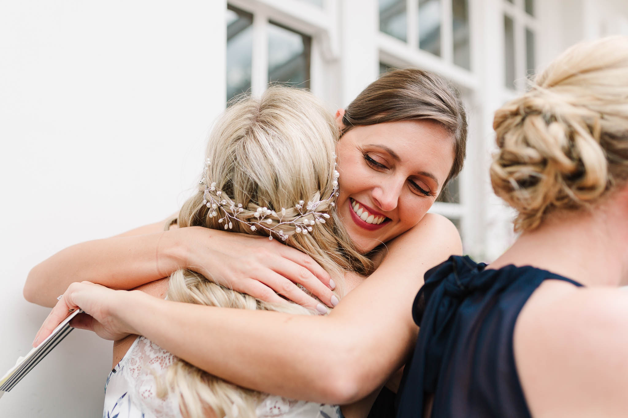bridesmaid hugging the bride- elegant london wedding