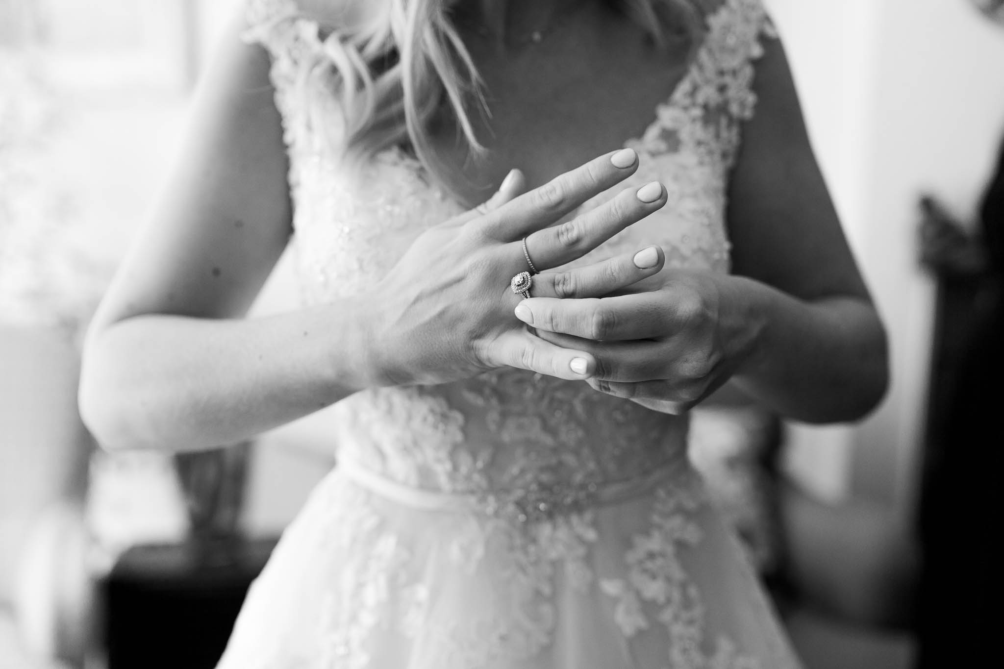 bride playing with her engagement ring