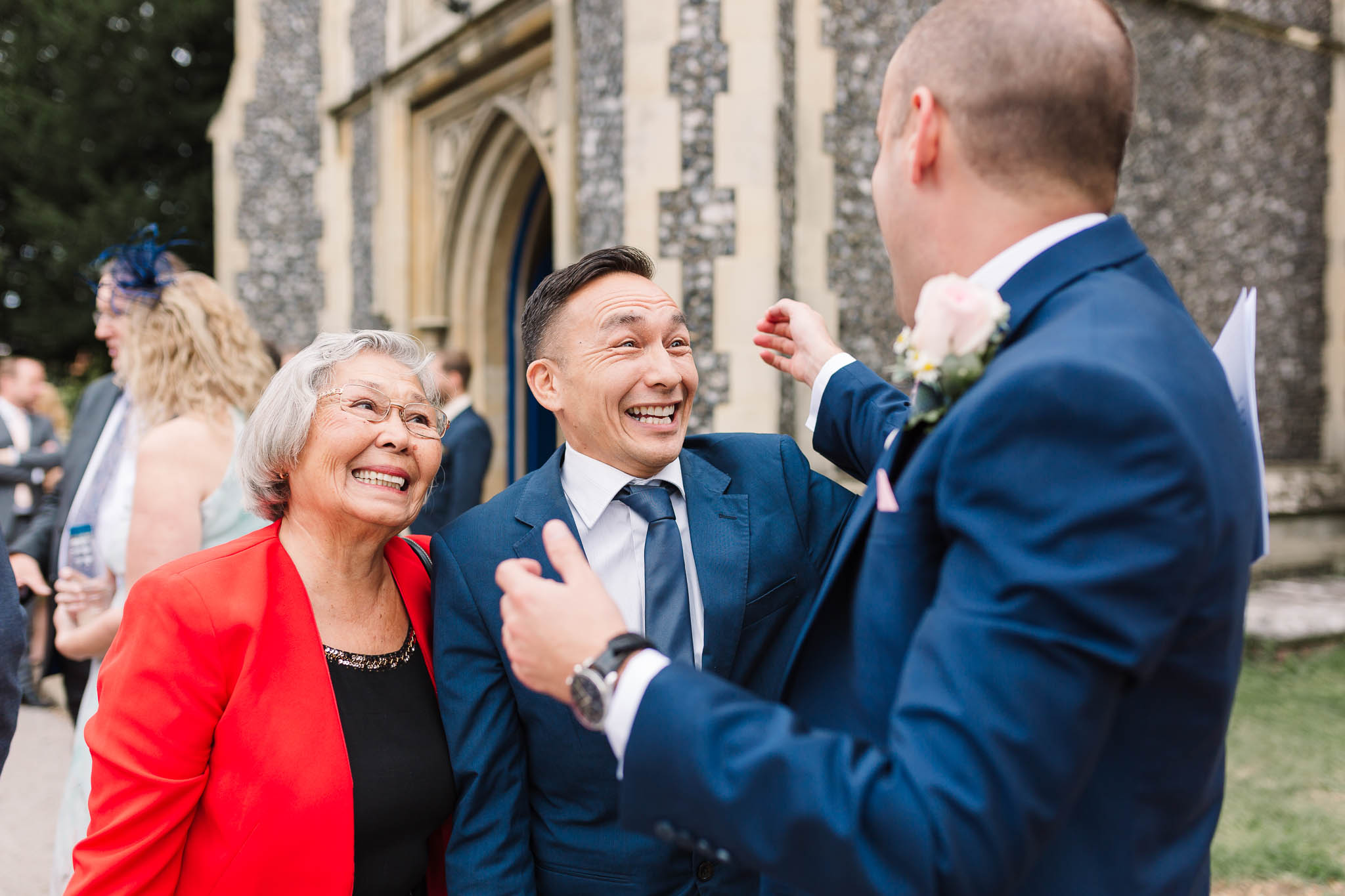 wedding guests greeting groom at church