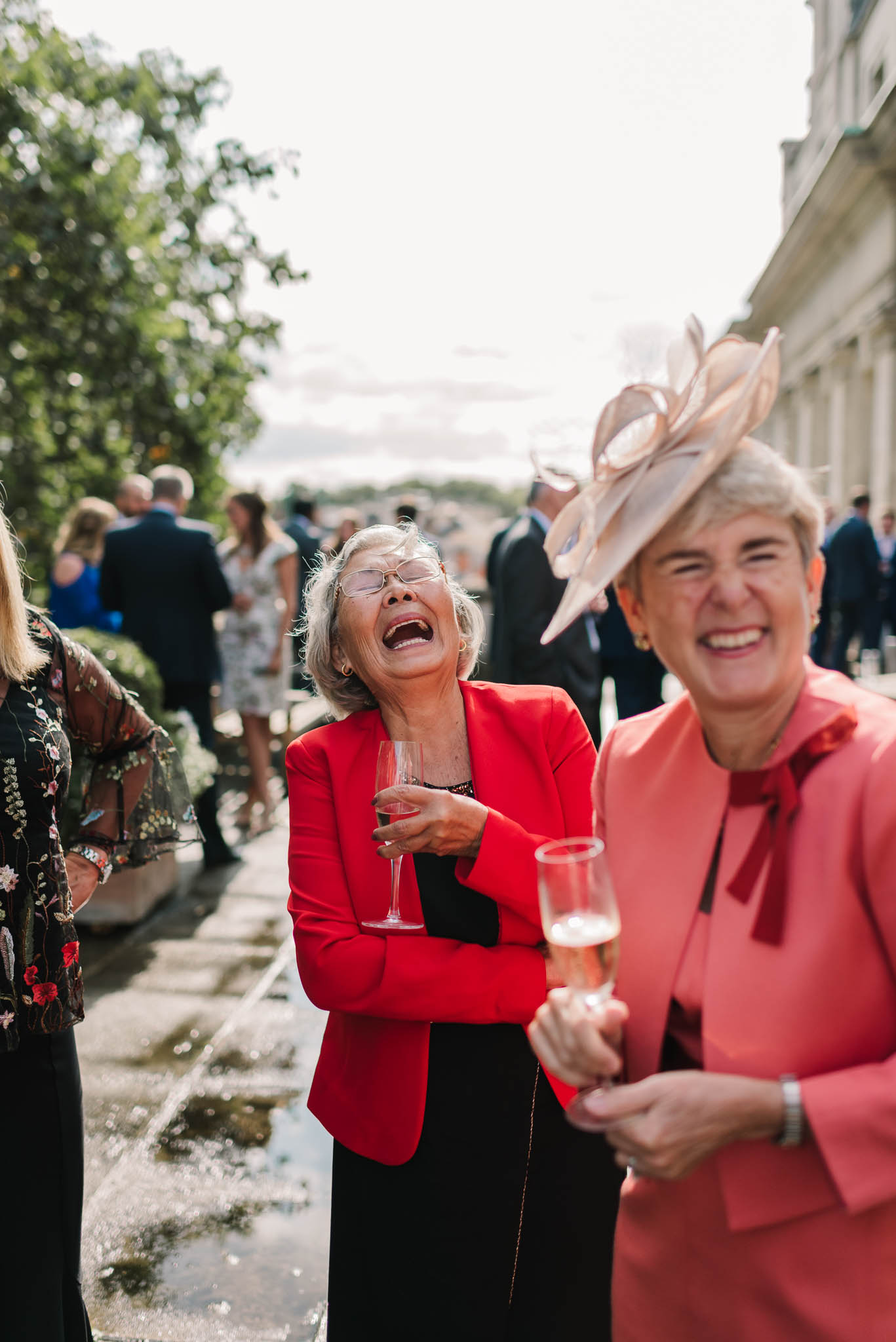 wedding guests laughing - Elegant London Wedding at the Royal Automobile Club