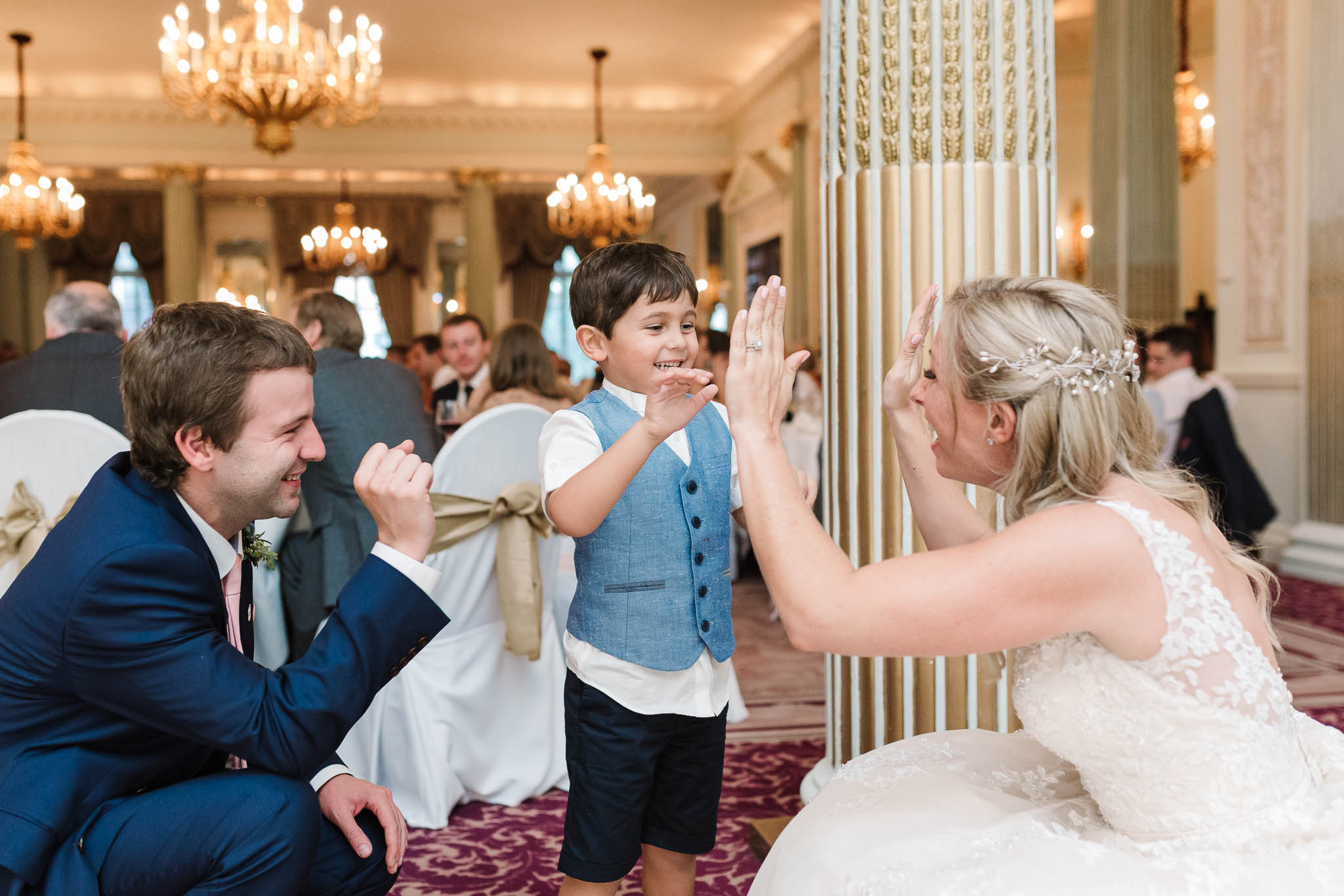 bride high-fiving page boy