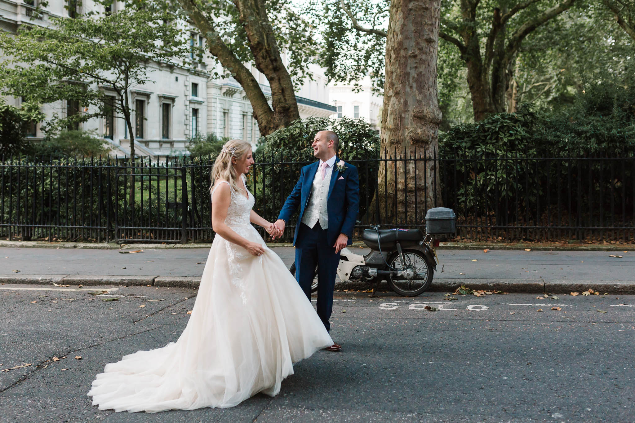 bride and grooms walking on london streets