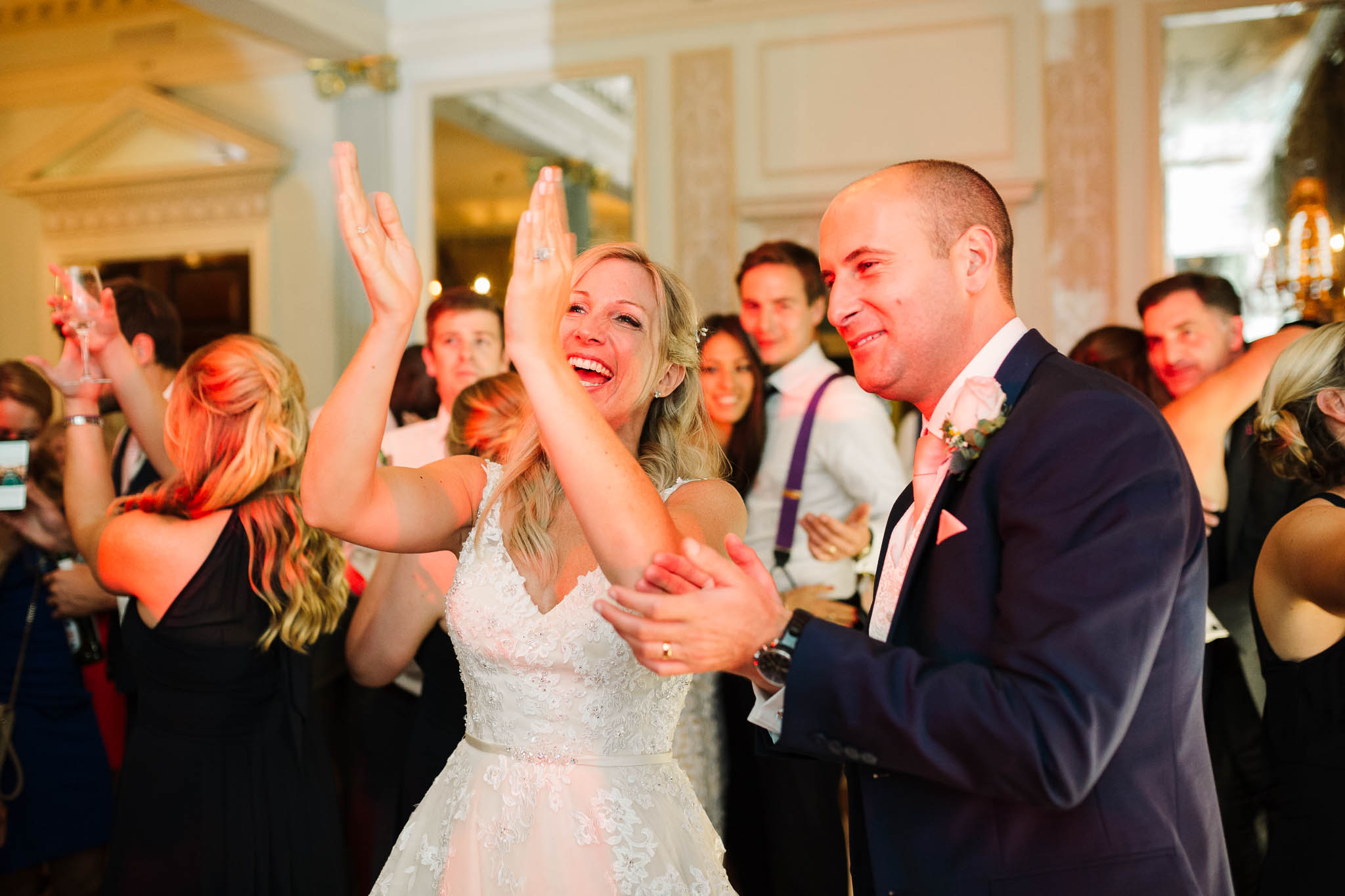 bride and groom clapping at first dance