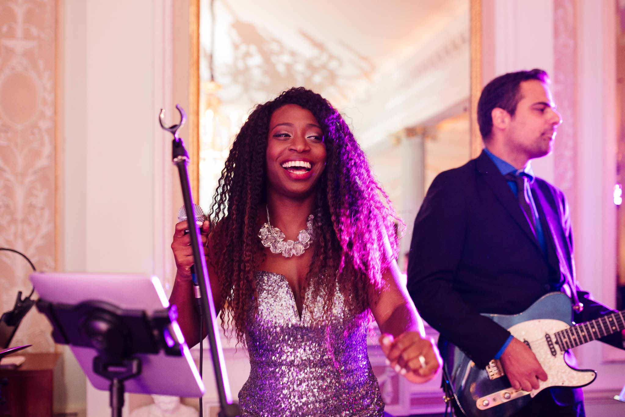singer smiling at wedding