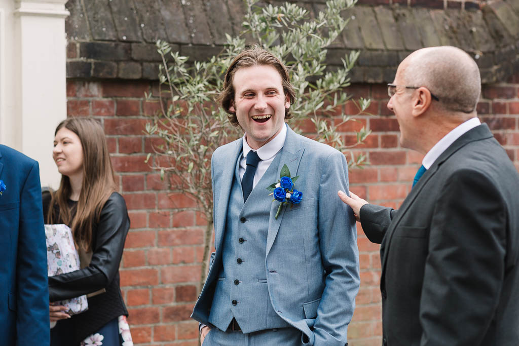 groom laughing - LANGTONS HOUSE WEDDING