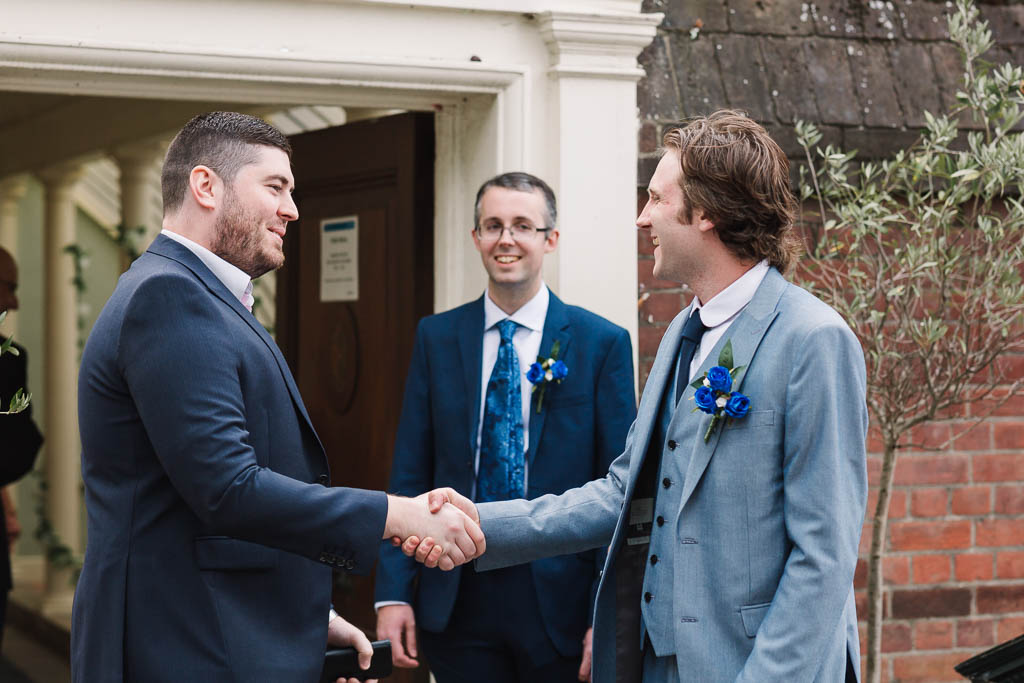 groom greeting guests at wedding