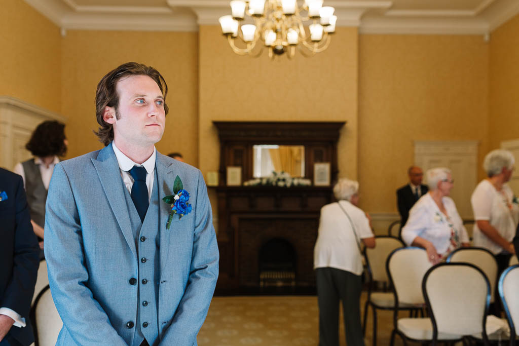 groom waiting for the bride to enter - LANGTONS HOUSE WEDDING