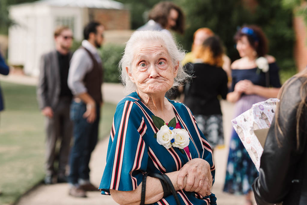nan pulling funny face at wedding