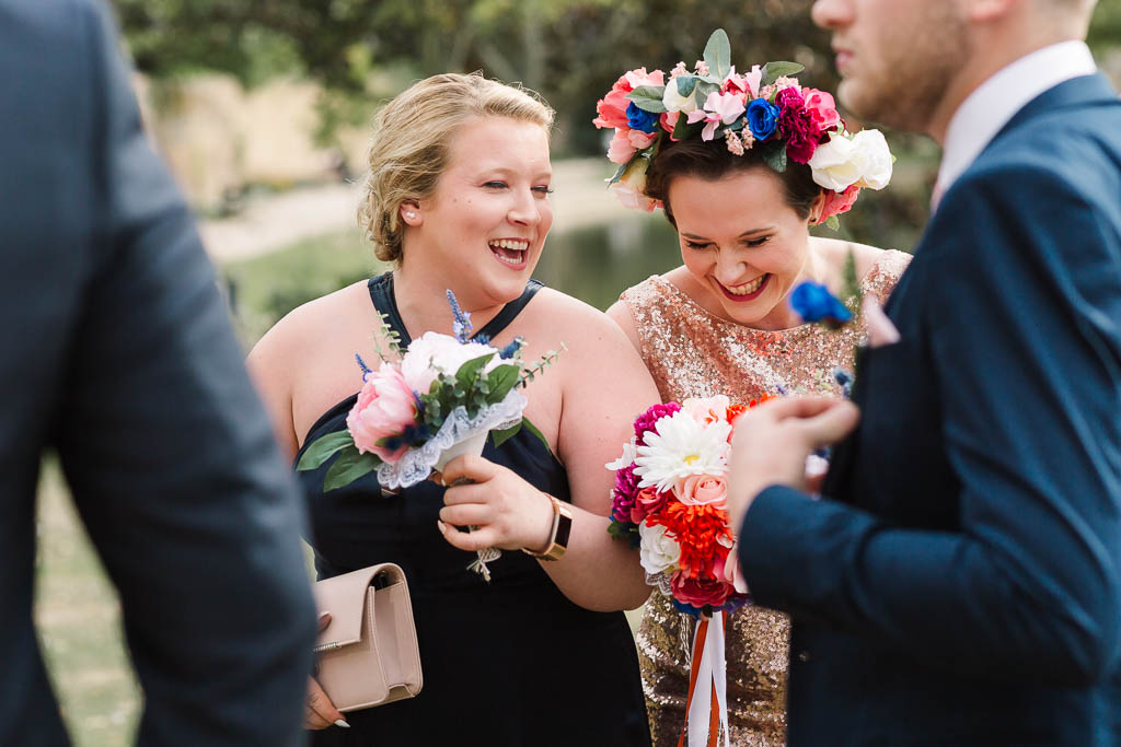 bride and bridesmaid laughing at Langtons House Wedding