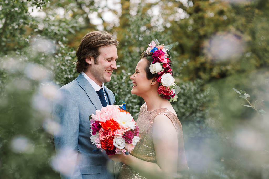 bride and groom laughing in gardens at Langtons House