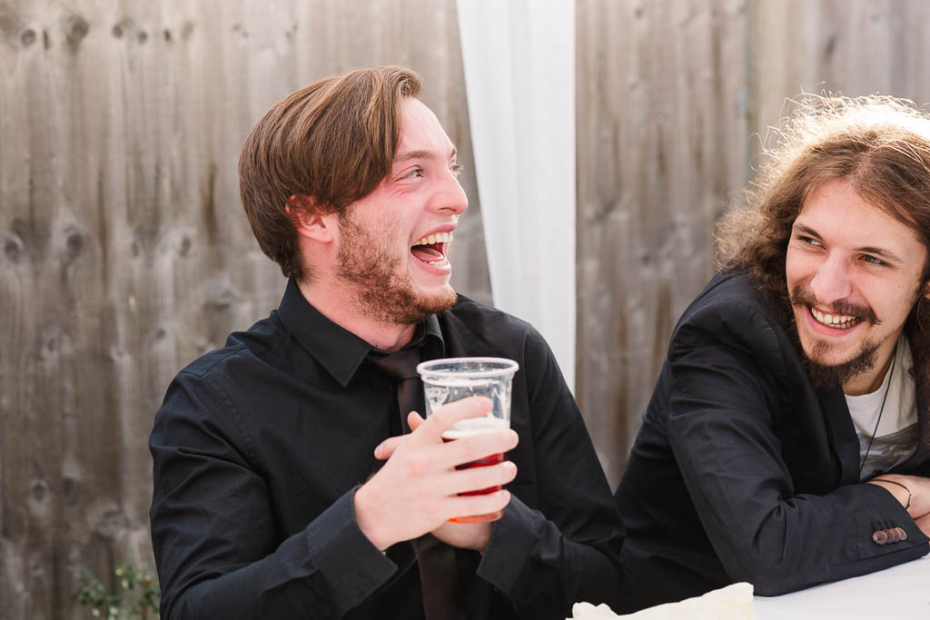 wedding guests laughing - LANGTONS HOUSE WEDDING AND CHILLED GARDEN RECEPTION AT HOME