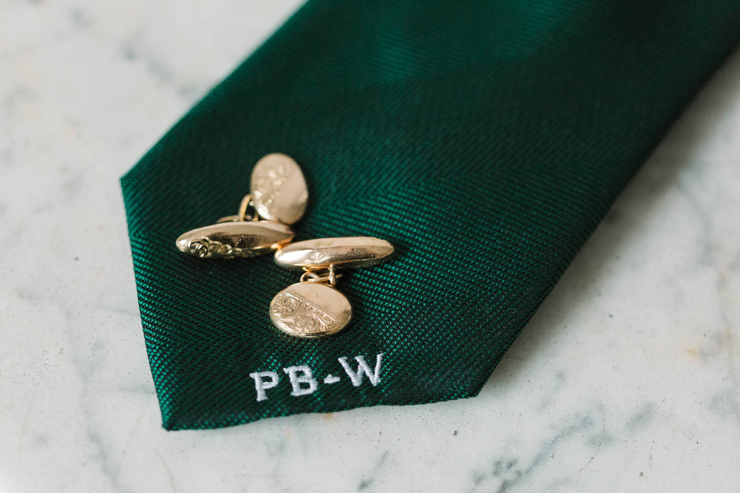 grooms embroidered initials on tie and cufflinks