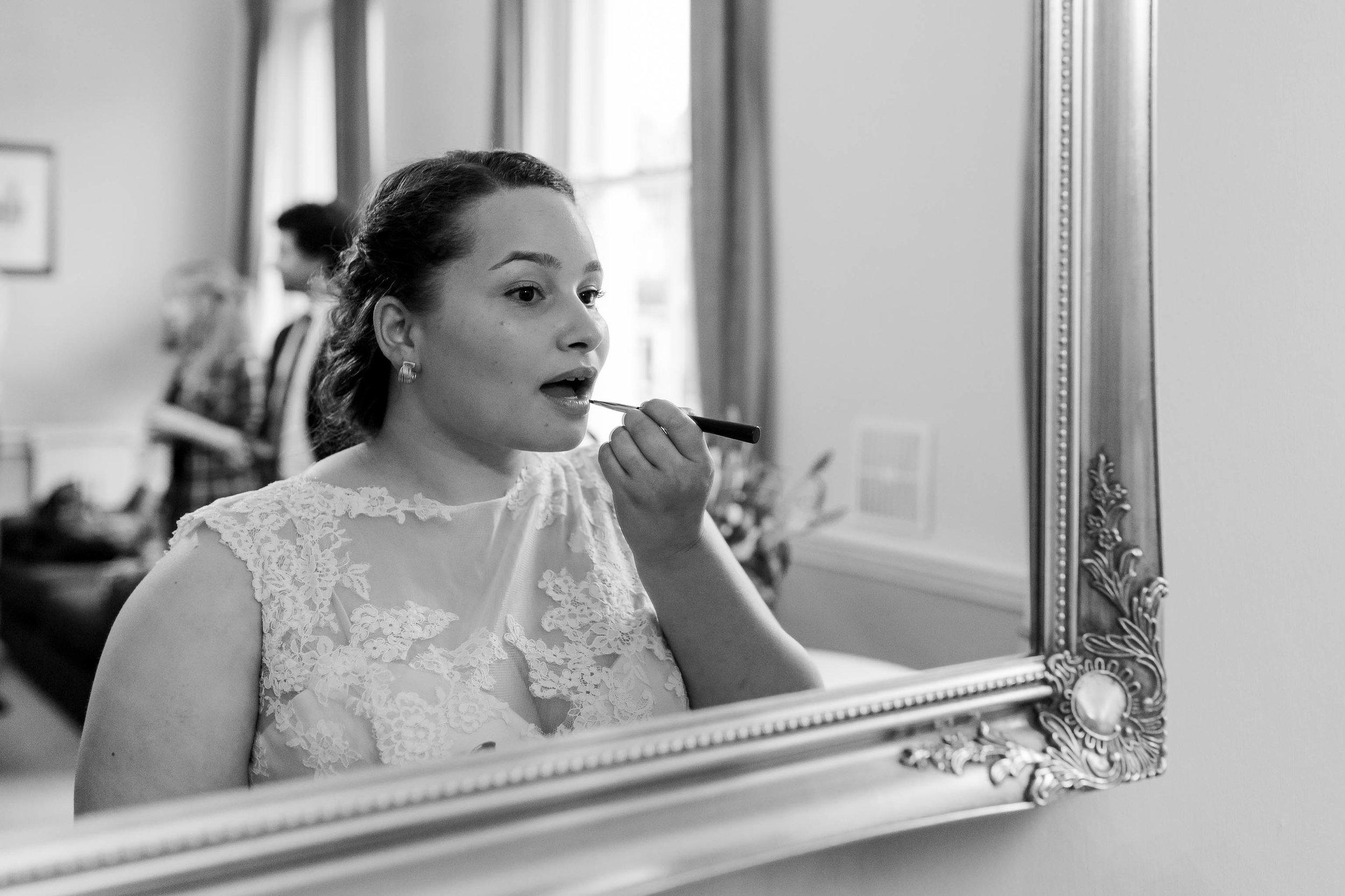 bride doing her lipstick