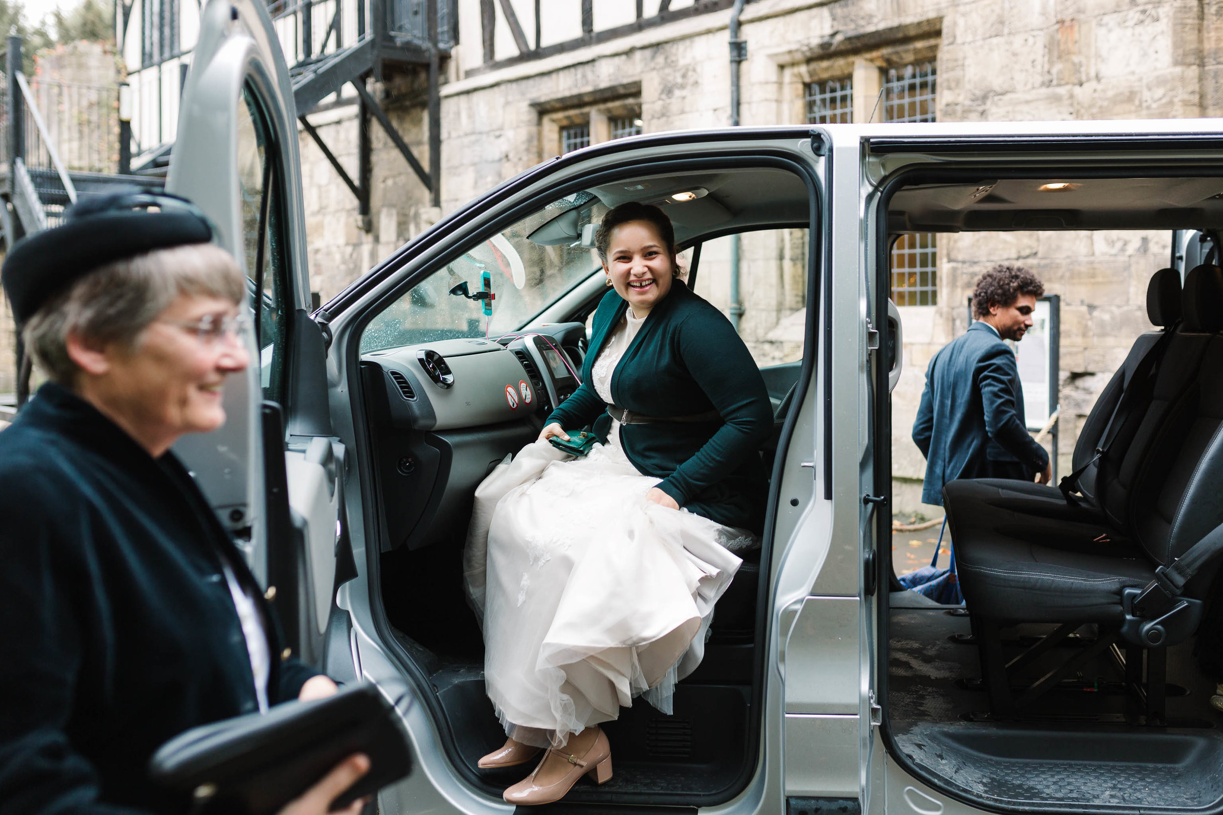 bride getting out of taxi at hospitium